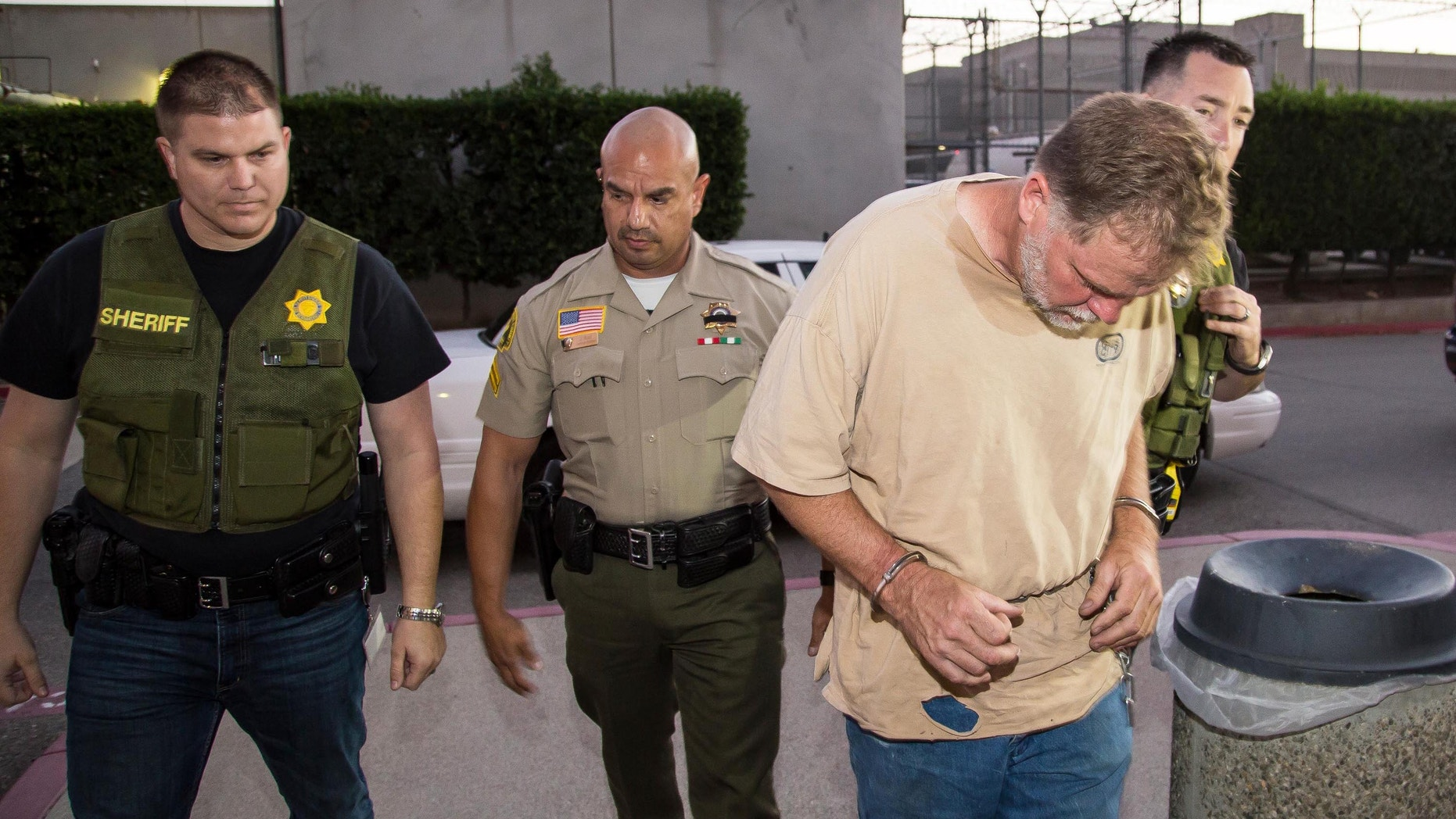 Nov. 5, 2014: This photo provided by the San Bernardino County Sheriff's office shows investigators from the San Bernardino County Sheriffs Department Homicide unit take Charles Merritt into custody for the murders of Joseph, Summer, Gianni and Joseph M. McStay in Victorville, Calif. (AP/San Bernardino County Sheriff)