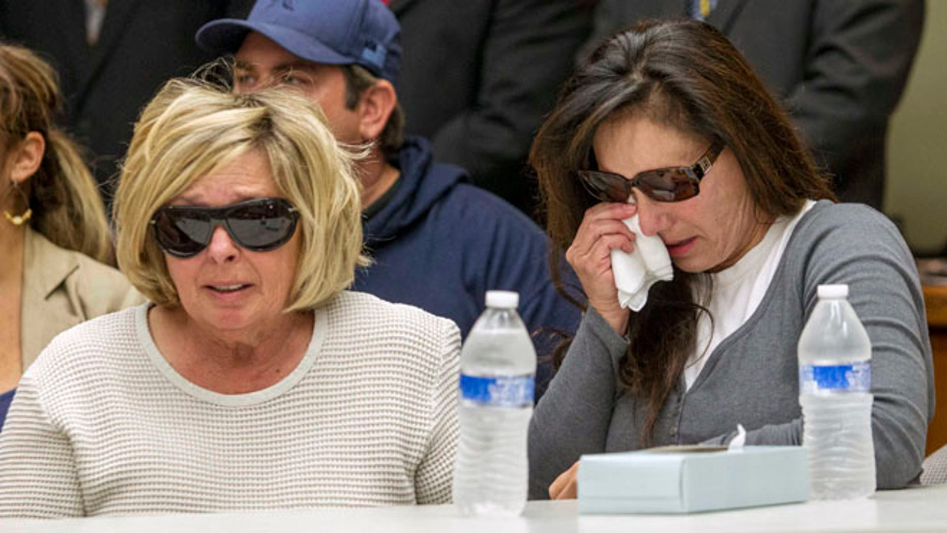 Nov. 15, 2013: Susan McStay, mother of Joseph McStay, left, and friend of victims' family, Emily, whose last name was not given, listen during a news conference at the San Bernardino County Sheriffs Department Headquarters.