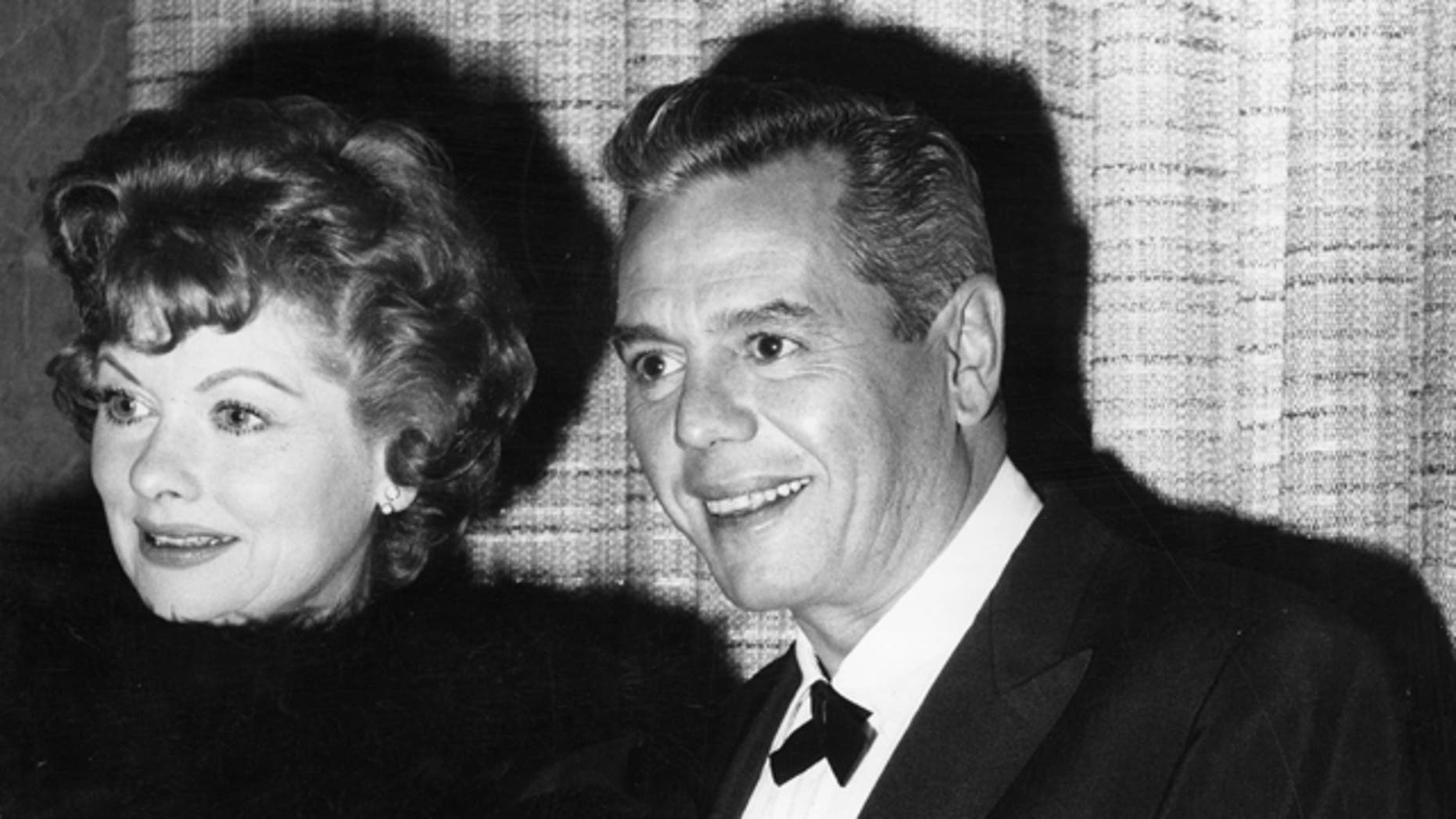 """File photo:  American actress Lucille Ball (1911 - 1989) with her Cuban husband and co-star of the popular TV show """"I Love Lucy,"""" Desi Arnaz (1917 - 1986). The celebrity couple set up the Desilu Studios together."""