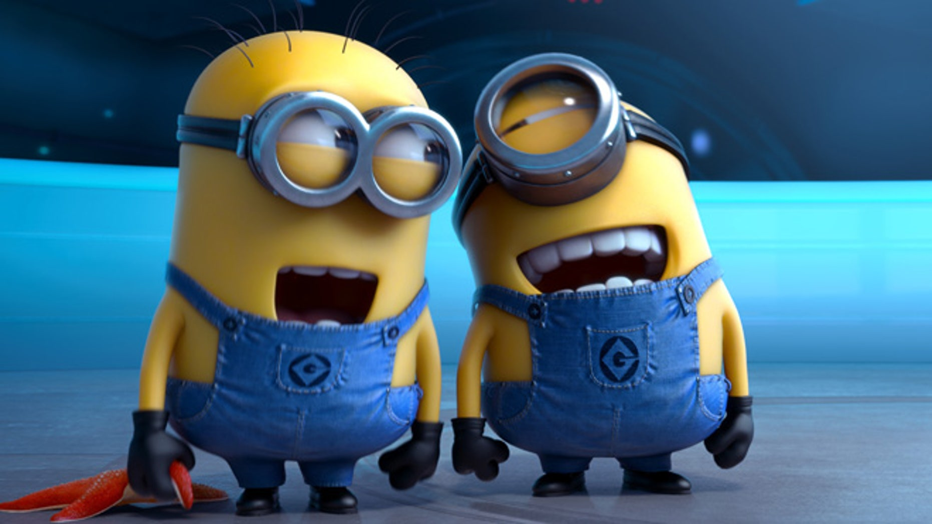 "This file photo provided by Universal Pictures shows the minion characters in the film ""Despicable Me 2."""