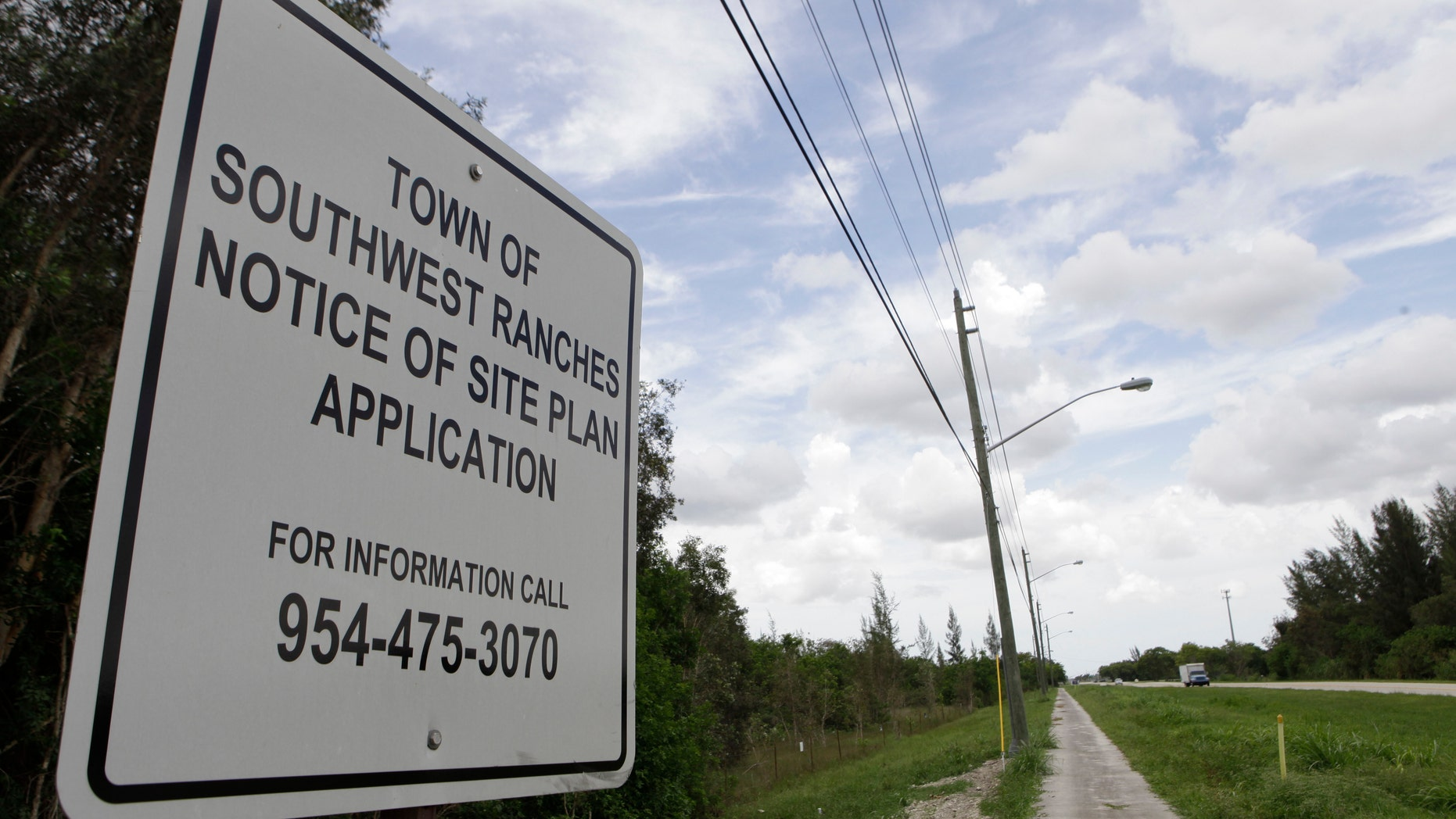 In this photo taken Tuesday, July 26, 2011, a sign is posted at the site for a proposed detention center to be built in Southwest Ranches, Fla.  Town leaders in this upscale rural enclave have plans to build a 1,500-bed detention center facility for U.S. Immigration and Customs Enforcement. A growing group of residents from Southwest Ranches and neighboring cities are seeking to halt the effort. (AP Photo/Lynne Sladky)