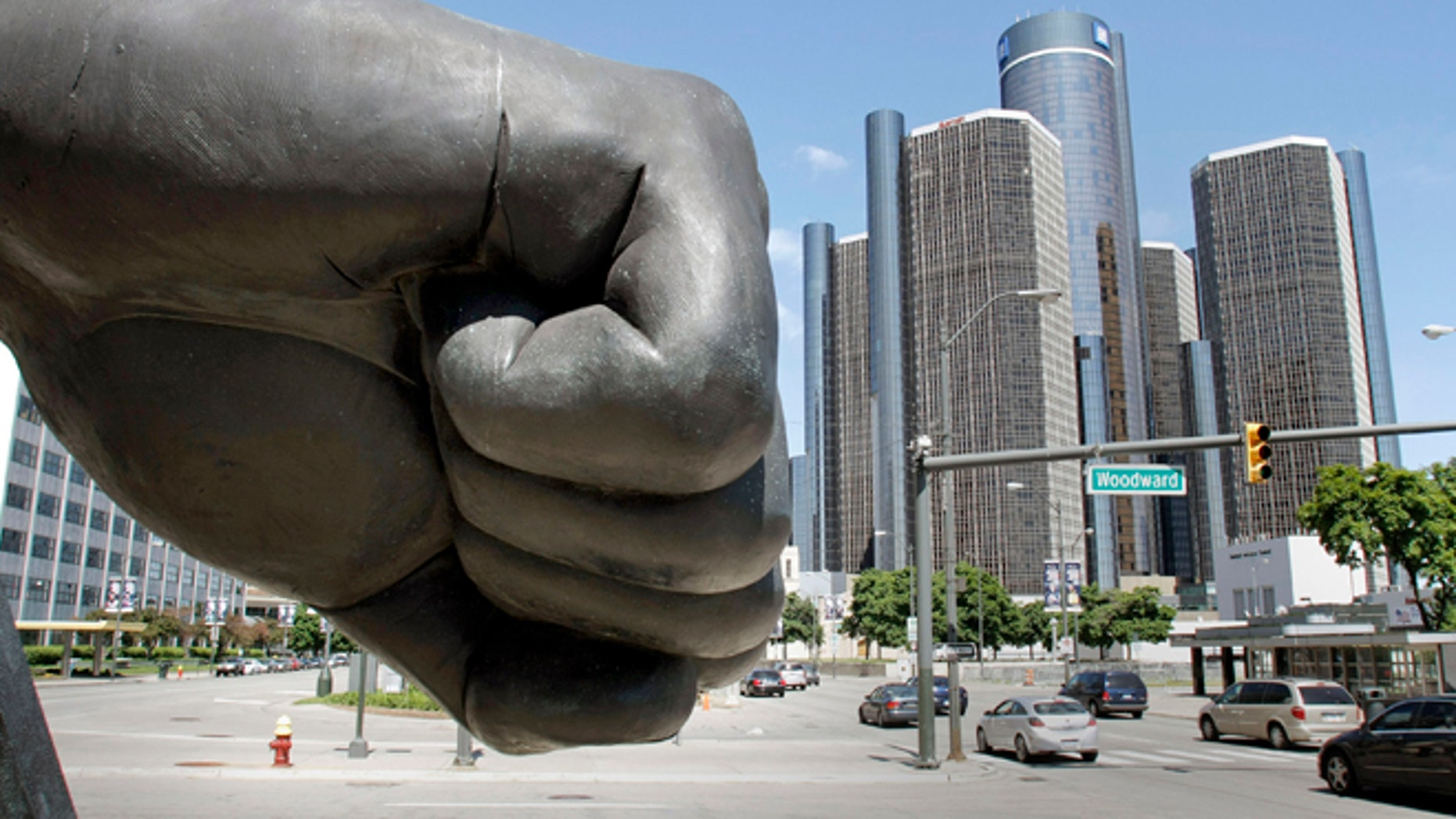 A hand of a large sculpture extends near the General Motors world headquarters on the eve of a possible GM bankruptcy filing May 31, 2009 in Detroit, Michigan.(Photo by Bill Pugliano/Getty Images)