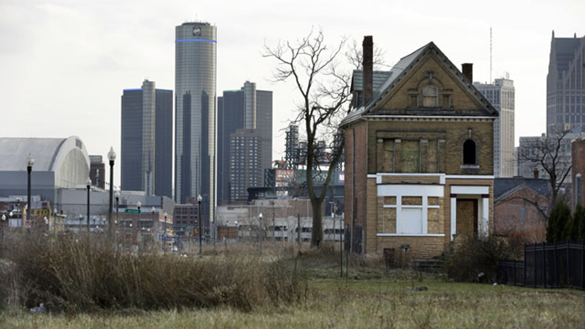 December 2, 2013: An empty field in Brush Park, north of Detroit's downtown, is shown with an abandoned home. (AP Photo)