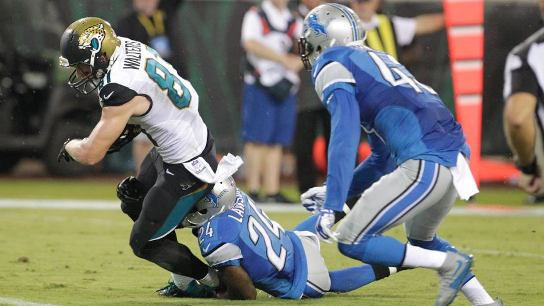 Aug 28, 2015; Jacksonville, FL, USA; Detroit Lions cornerback Nevin Lawson (24) cannot stop Jacksonville Jaguars wide receiver Bryan Walters (81) from scoring a touchdown during the second half of an NFL preseason football game at EverBank Field. The Lions won 22-17. Mandatory Credit: Reinhold Matay-USA TODAY Sports