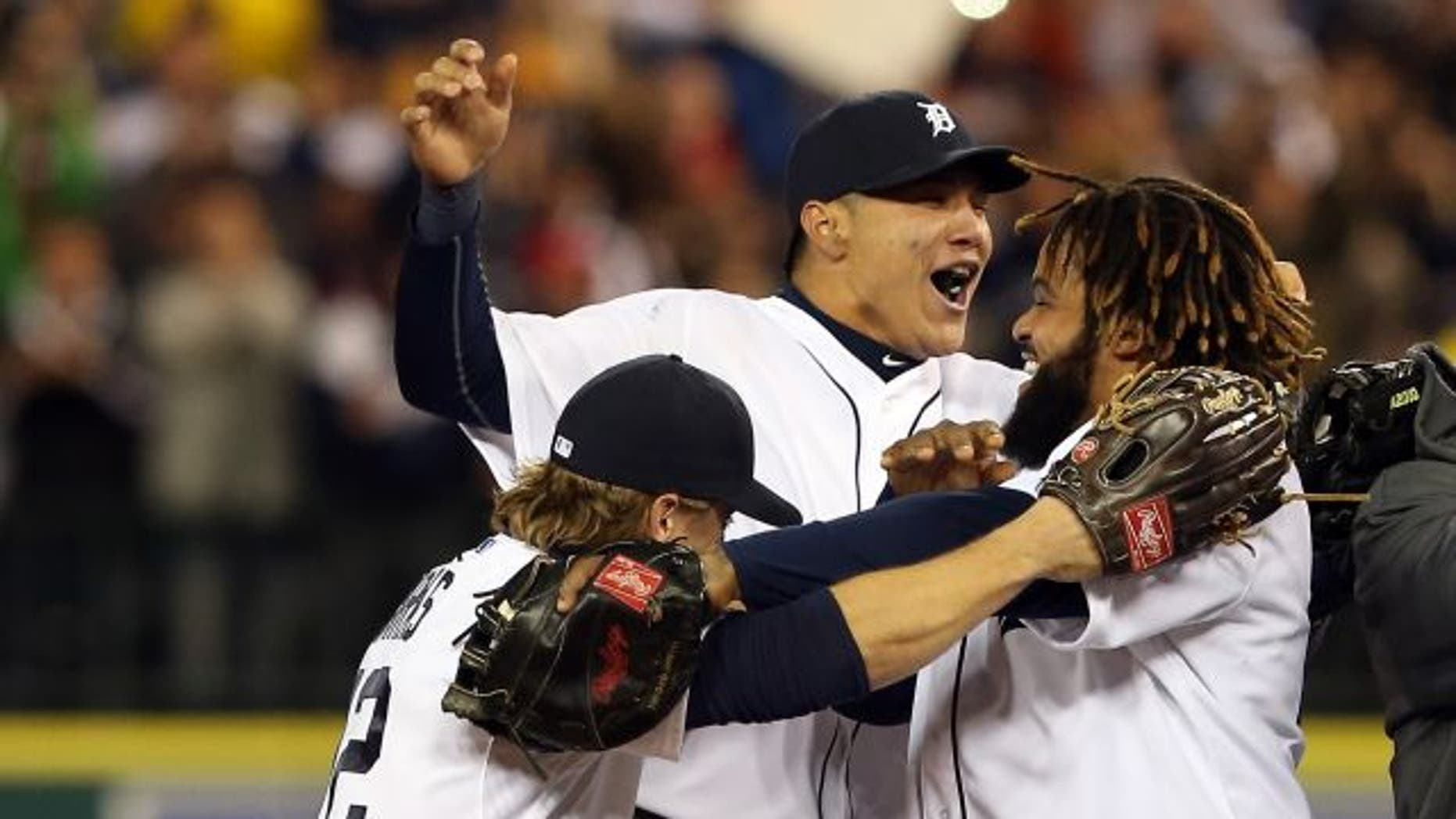 DETROIT, MI - OCTOBER 18:  (L-R) Andy Dirks #12, Avisail Garcia #34 and Prince Fielder #28 of the Detroit Tigers celebrate after they won 8-1 against the New York Yankees during game four of the American League Championship Series at Comerica Park on October 18, 2012 in Detroit, Michigan.  (Photo by Leon Halip/Getty Images)