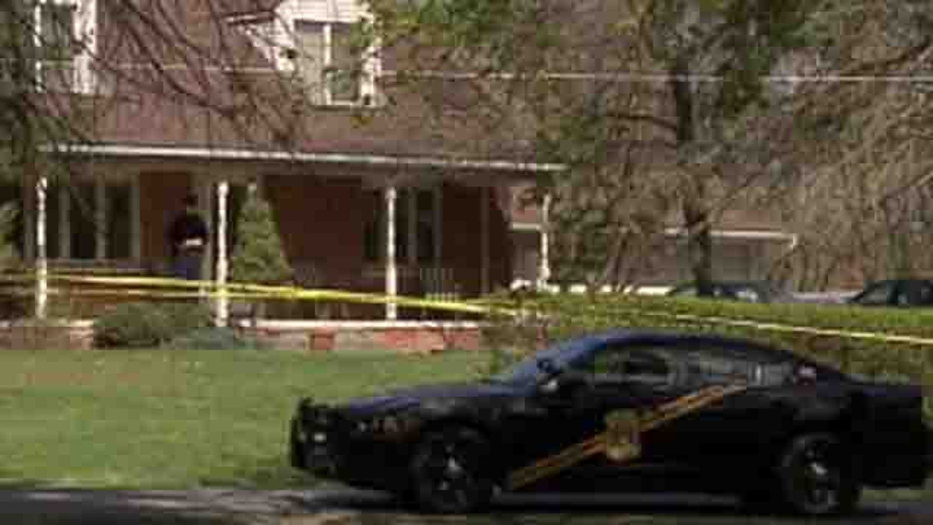 April 4, 2012: Police are seen outside the home where an apparent triple murder-suicide occurred.