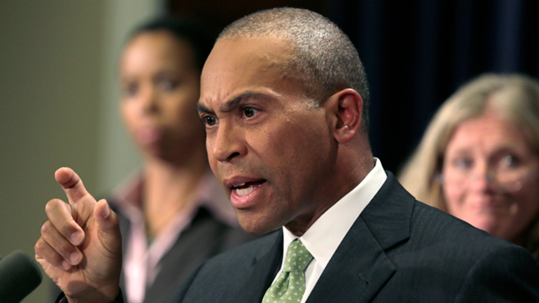 Oct. 23, 2012: Mass. Gov. Deval Patrick gestures during a news conference regarding the Massachusetts pharmacy responsible for the meningitis outbreak during a news conference at the Statehouse in Boston.