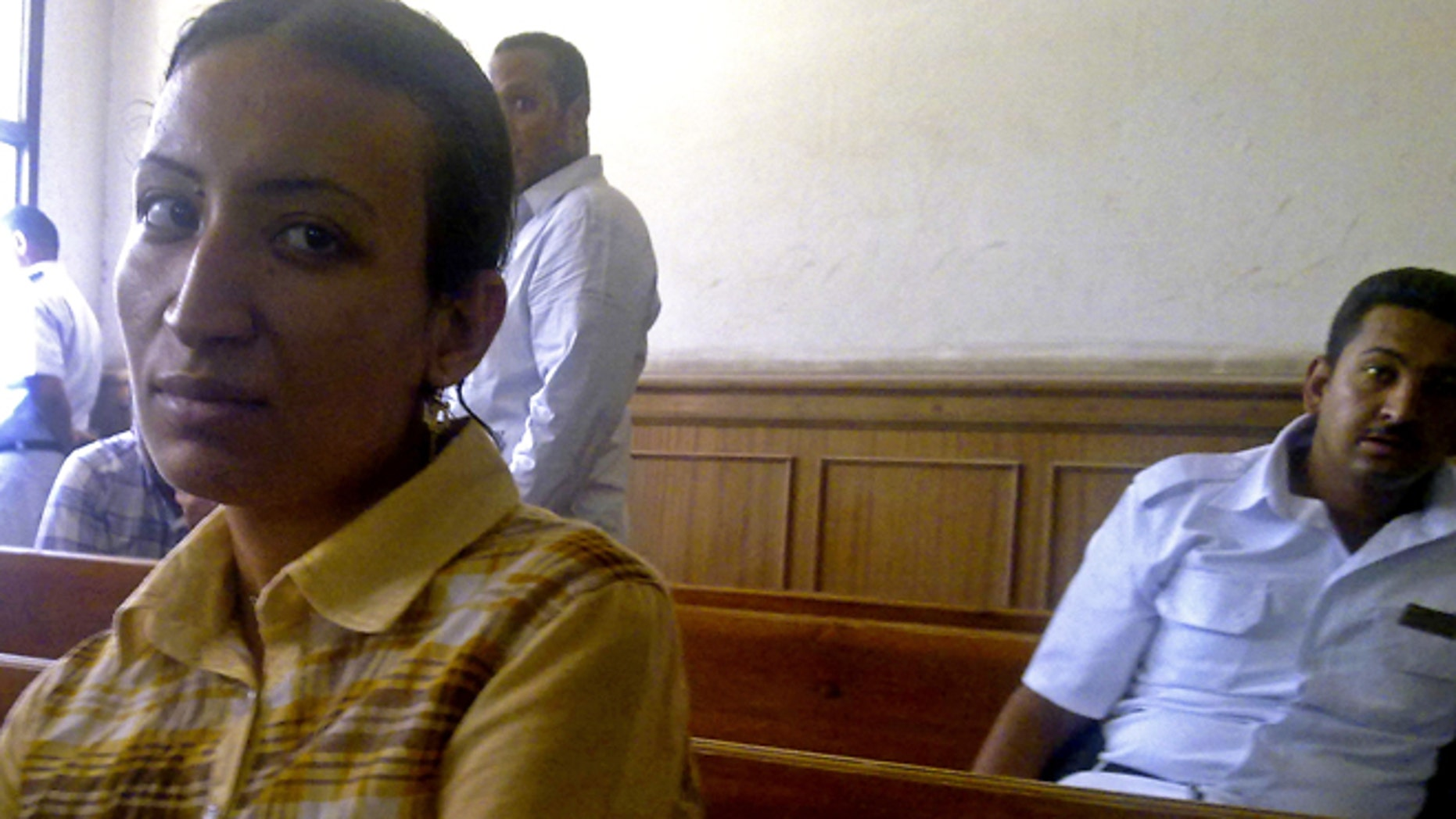 This Saturday, May 11, 2013 photo, provided by the lawyer of  Dimyana Abdel-Nour, shows Abdel-Nour, 24, a Coptic Christian teacher, in a courtroom in the southern Egyptian city of Luxor, Egypt.