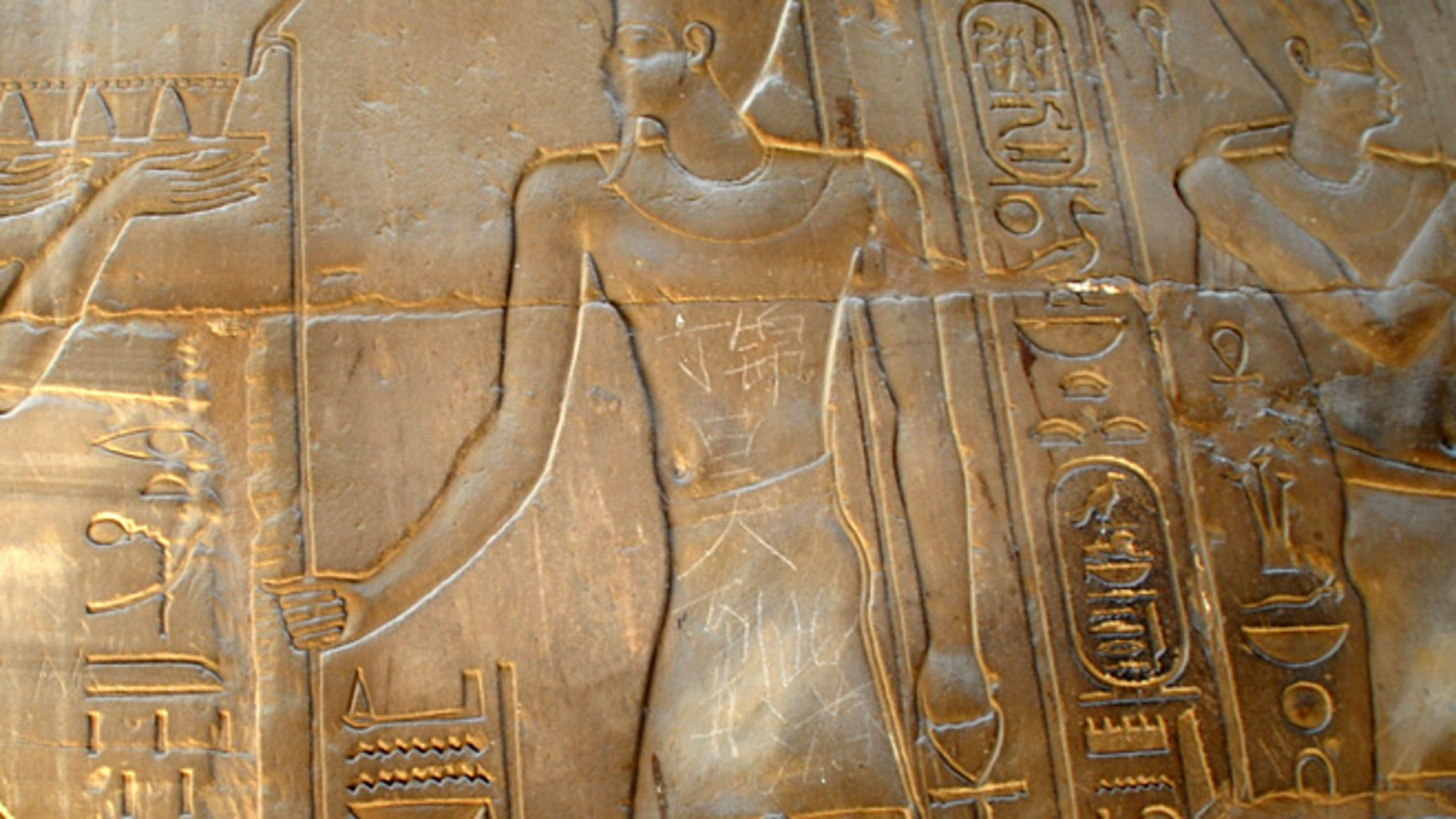 """May 6, 2013:  In this photo, the Chinese words """"Ding Jinhao visited here"""" is seen on bas-relief in the 3,500-year-old Luxor temple in Luxor, Egypt."""