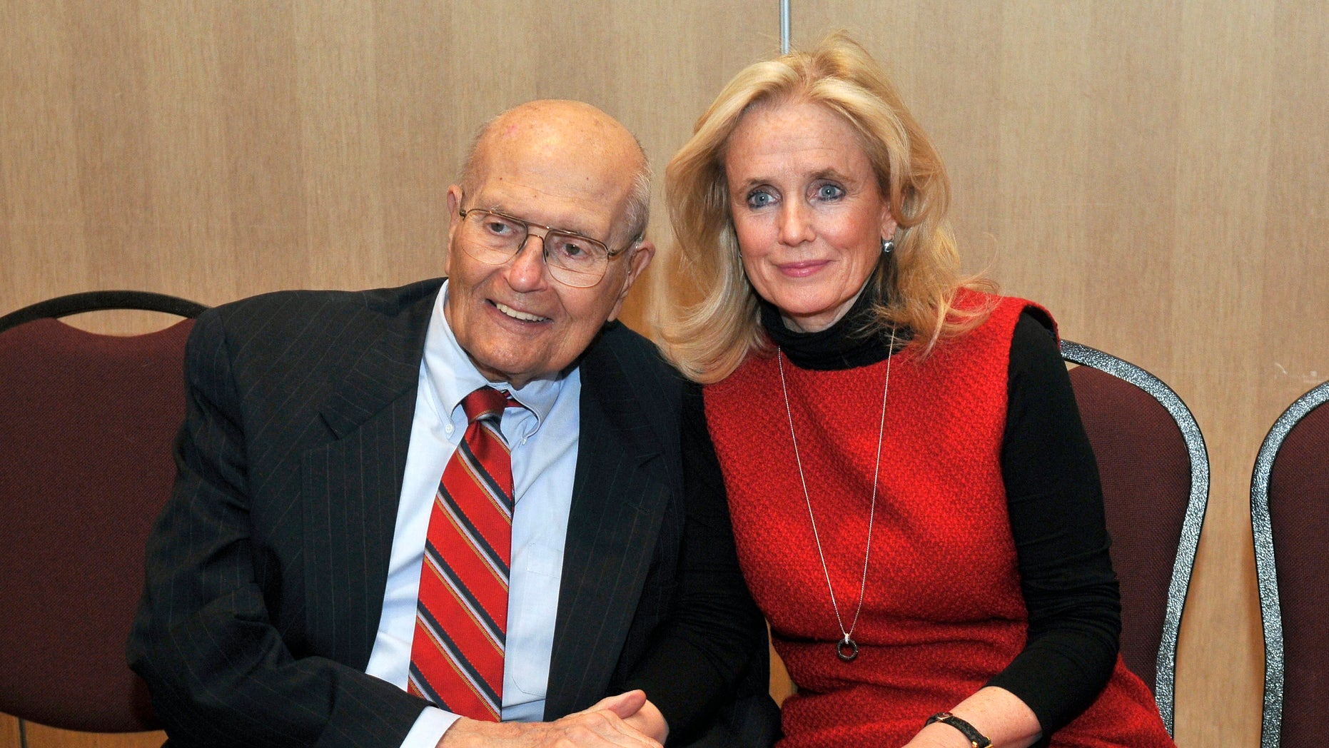 Feb. 24, 2014: U.S. Rep. John Dingell, left, and his wife Debbie hold hands during a legislative forum at the Southern Wayne County Regional Chamber (SWCRC) at the Crystal Gardens in Southgate, Mich.