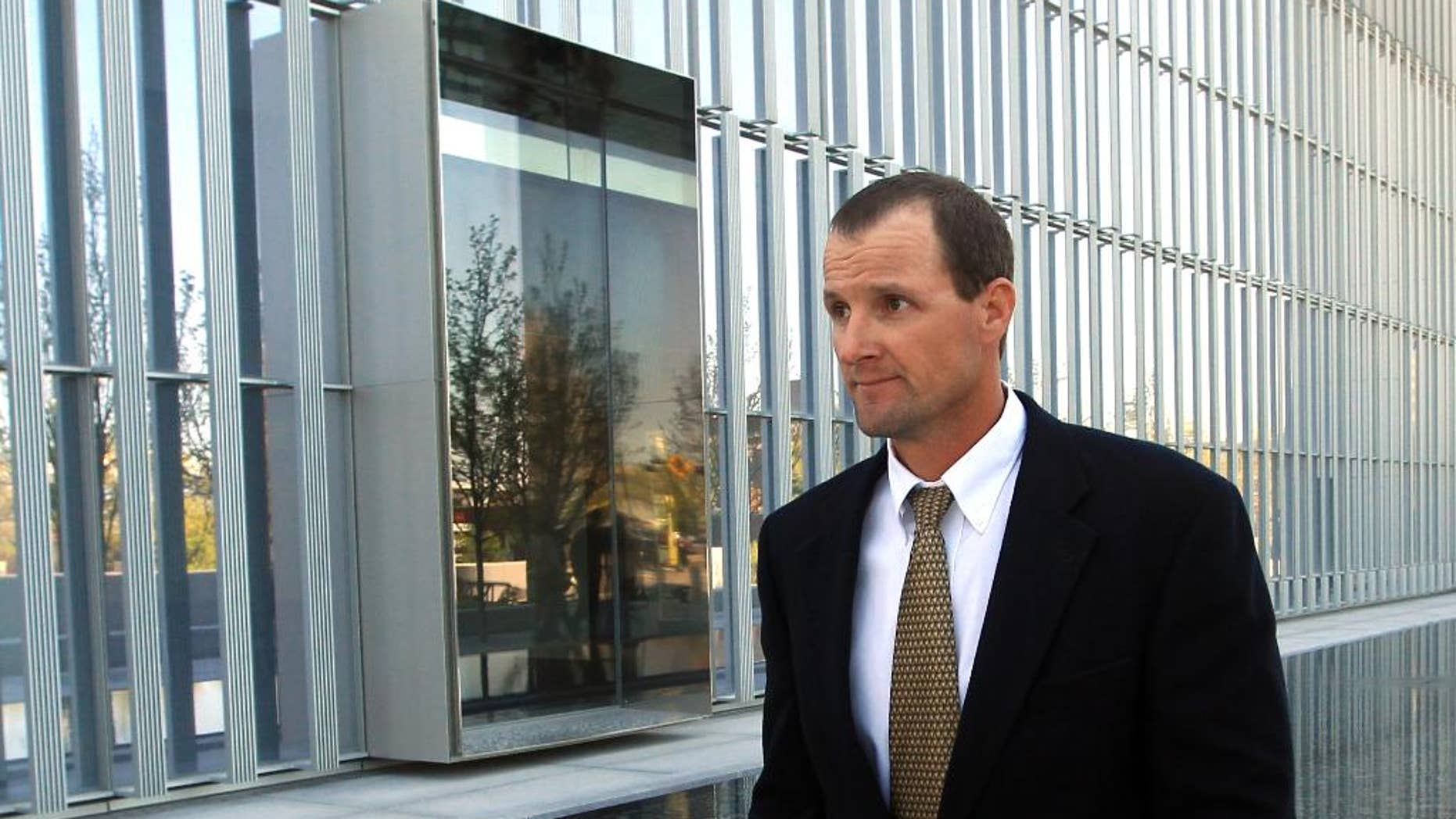 Jared Ehlers, of Moab, walks from the Federal Courthouse after appearing in court Wednesday, April 30, 2014, in Salt Lake City. Ehlers has has pleaded not guilty to federal charges of stealing a fossilized dinosaur footprint. He is accused of dislodging a piece of sandstone with a three-toed ancient dinosaur track from the Hell's Revenge jeep Trail in the Sand Flats Recreation Area near Moab.   Ehlers is charged under a federal law passed in 2009 to protect paleontological artifacts. (AP Photo/Rick Bowmer)