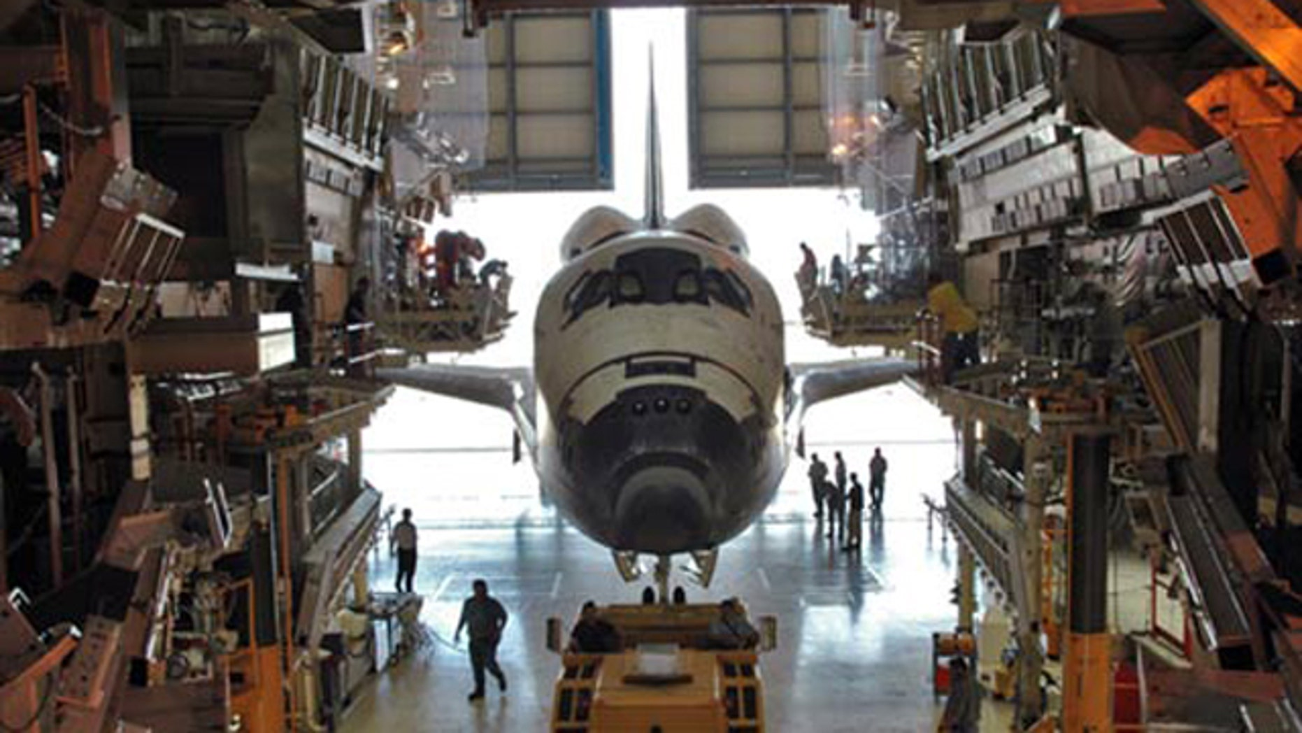 The space shuttle Discovery is shown inside its Orbital Processing Facility, a maintenance hangar used to service the spacecraft in between spaceflights, in this 2005 photo.