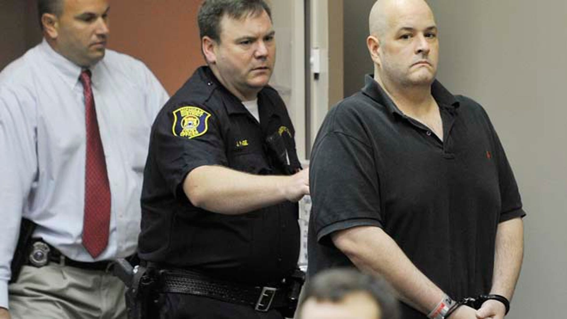 Aug. 20, 2012: In this file photo, Roger Bowling, right, is escorted into a courtroom by police and detectives for a preliminary examination at the 24th District Court in Allen Park, Mich. (AP/The Detroit News)