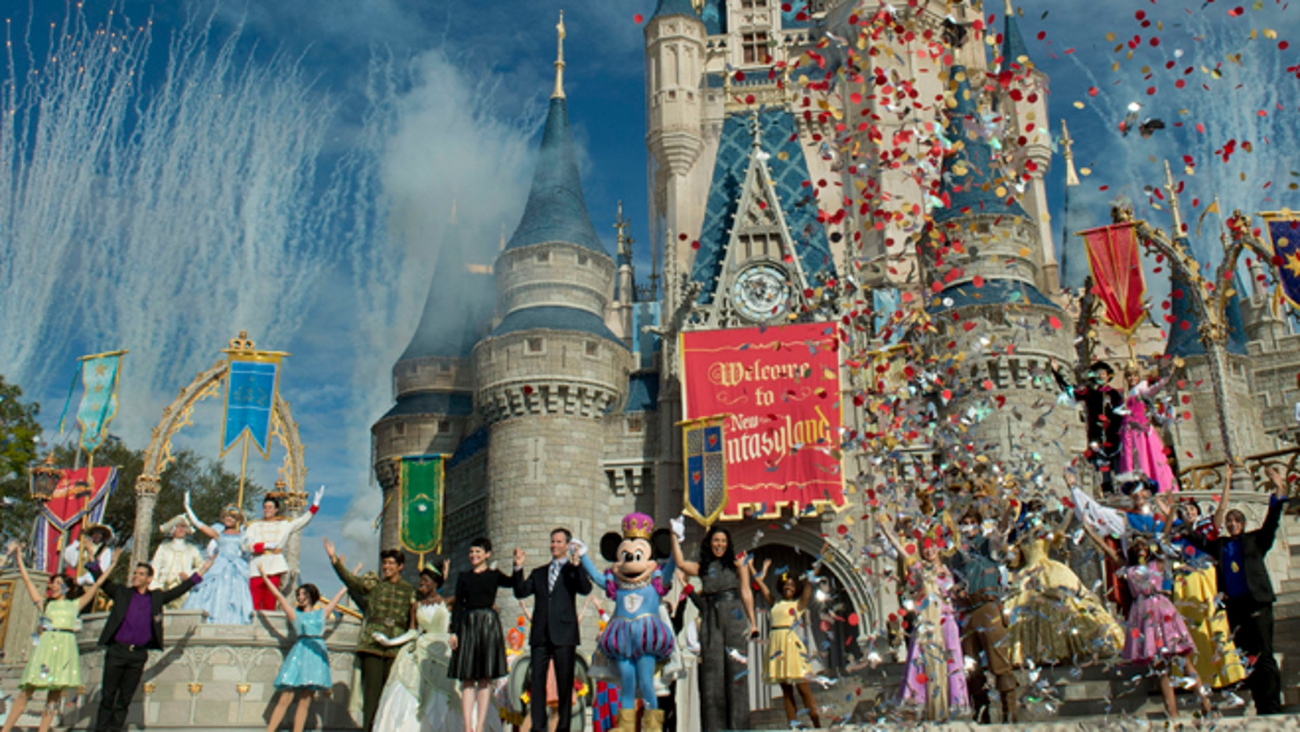 LAKE BUENA VISTA, FL - DECEMBER 06:  In this handout image provided by Disney Parks, fireworks and confetti fly at Cinderella Castle during the Grand Opening of New Fantasyland at Walt Disney World Resort December 6, 2012 in Lake Buena Vista, Florida.  Actress Ginnifer Goodwin, Disney Parks and Resorts Chairman Tom Staggs, singer Jordin Sparks and Mickey Mouse joined dozens of Disney characters on Cinderella Castle stage to celebrate the opening. New Fantasyland is a new area in the Magic Kingdom and is the largest expansion in the 41-year history of the theme park.  (Photo by Kent Phillips/Disney Parks via Getty Images)