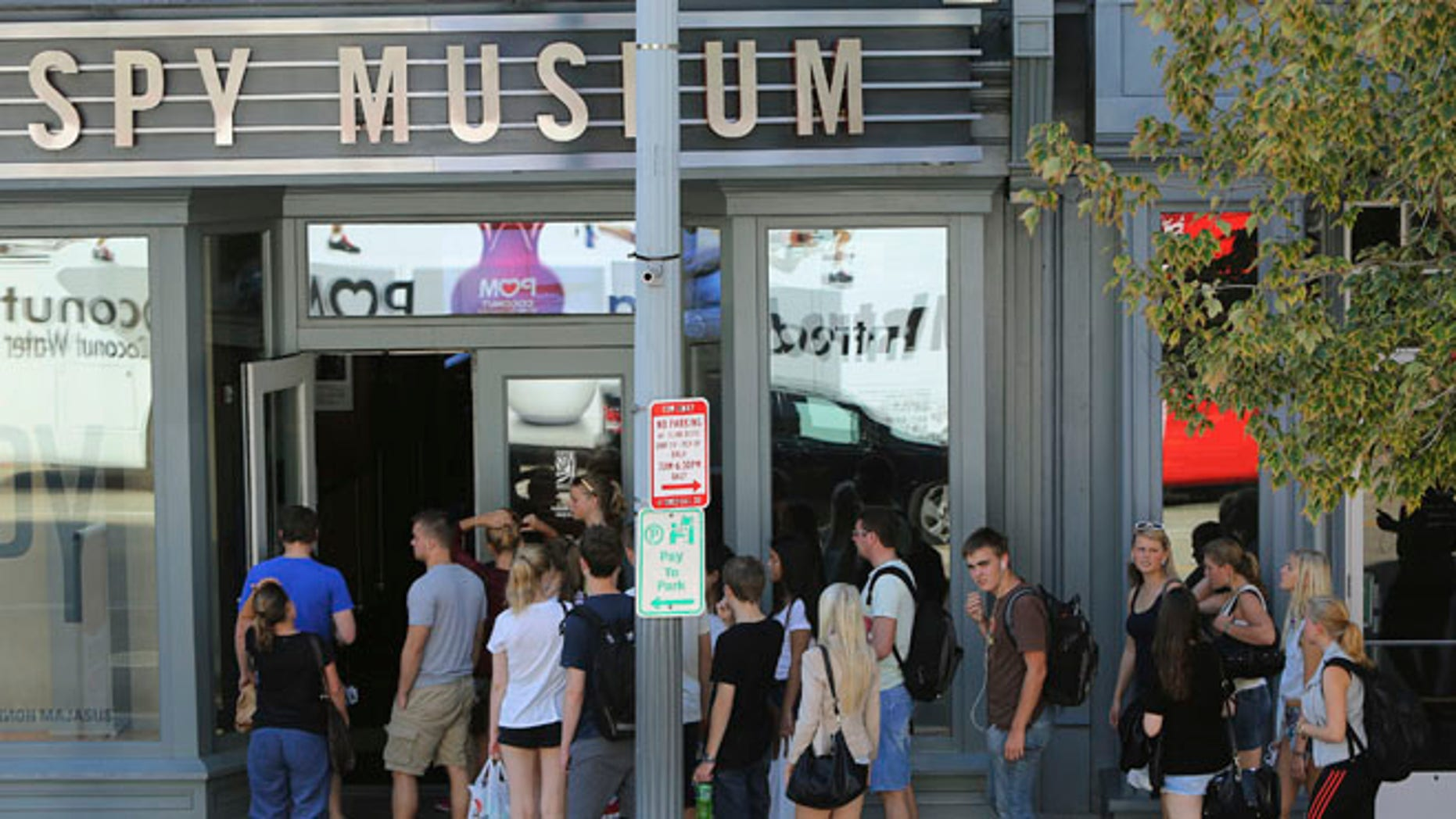FILE: Oct. 2, 2013: Tourists outside the International Spy Museum, which is open for business and not U.S. government-affiliated, in Washington, D.C.