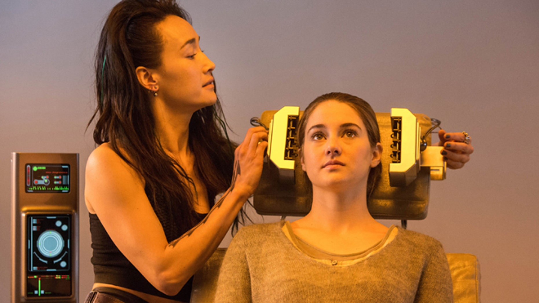 """This photo released by Summit Entertainment, LLC shows Maggie Q, left, as Tori and Shailene Woodley as Beatrice """"Tris"""" Prior, in the film, """"Divergent."""" The film releases Friday, March 21, 2014. (AP Photo/Summit Entertainment, Jaap Buitendijk)"""