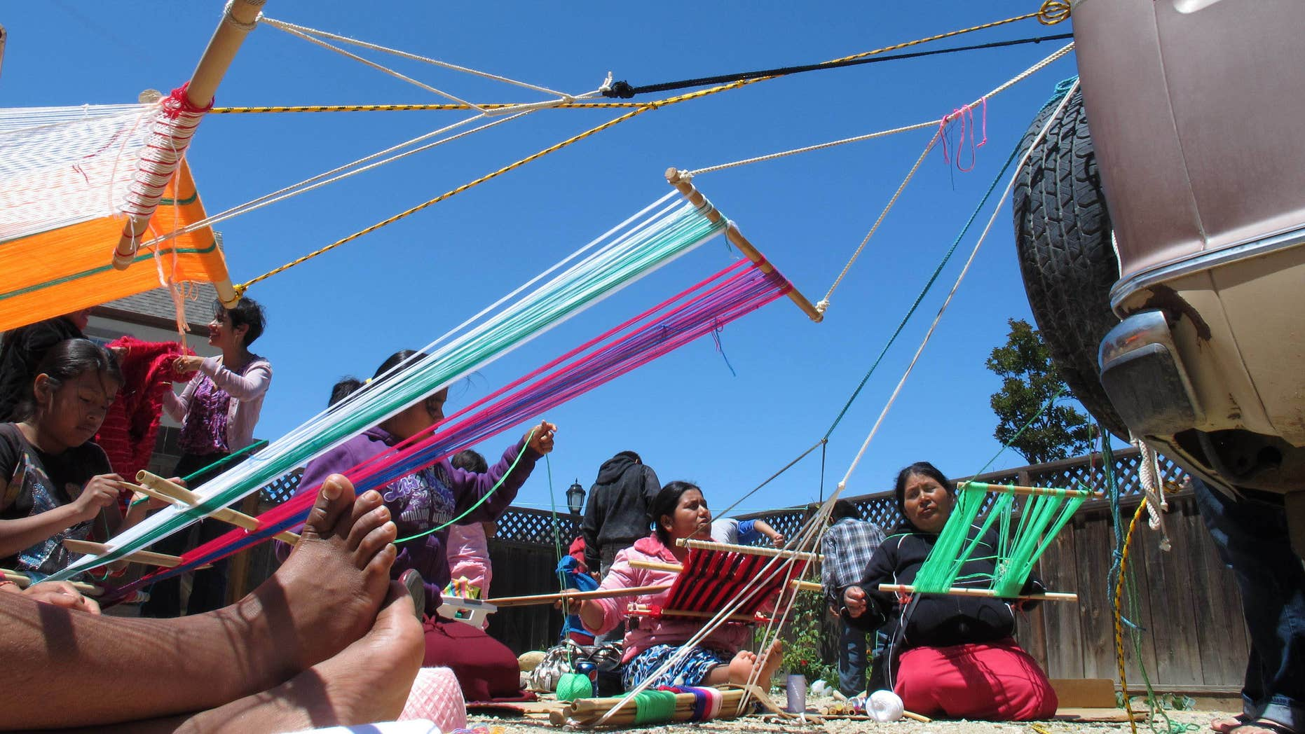 May 29: A group of women from the Mexican state of Oaxaca gather at a weaving workshop in Greenfield, California. Thousands of Trique, Mixtec and other Indians, the indigenous people of Mexico, have streamed in recent years from small mountain villages to Greenfield to plant and pick crops. Nearly all of Greenfield's 16,300 people are Latino - and yet an ugly conflict has been brewing between longer-time residents and newcomers.