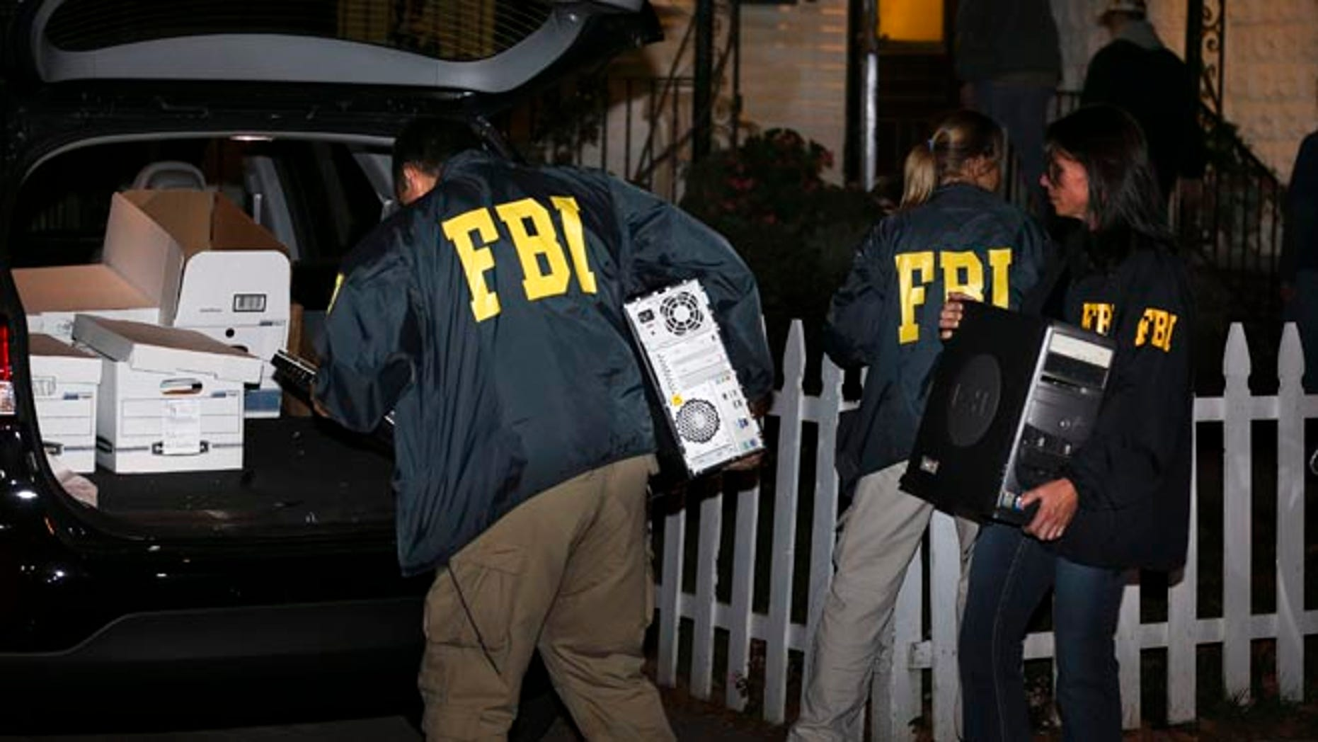 Oct. 10, 2013 FBI agents remove evidence from the Brooklyn residence of Rabbi Mendel Epstein during an investigation in New York.