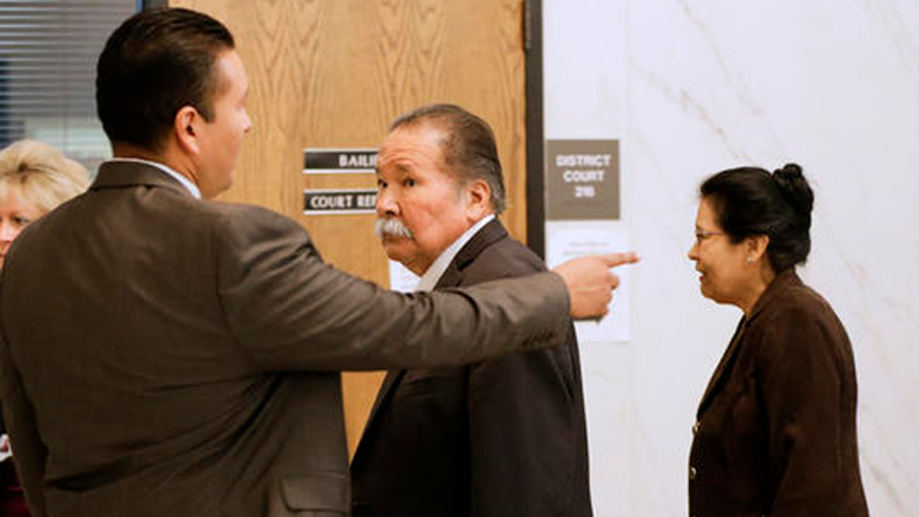 Frederick and Estella Garcia, along with their son Fernando, left, arrive to the Douglas County Courtroom in Omaha, Neb., Monday, Oct. 3, 2016, as lawyers gave opening statements in the first-degree murder trial of their son Anthony Garcia, charged in the killings of four people with ties to Creighton University's medical school. (AP Photo/Nati Harnik)