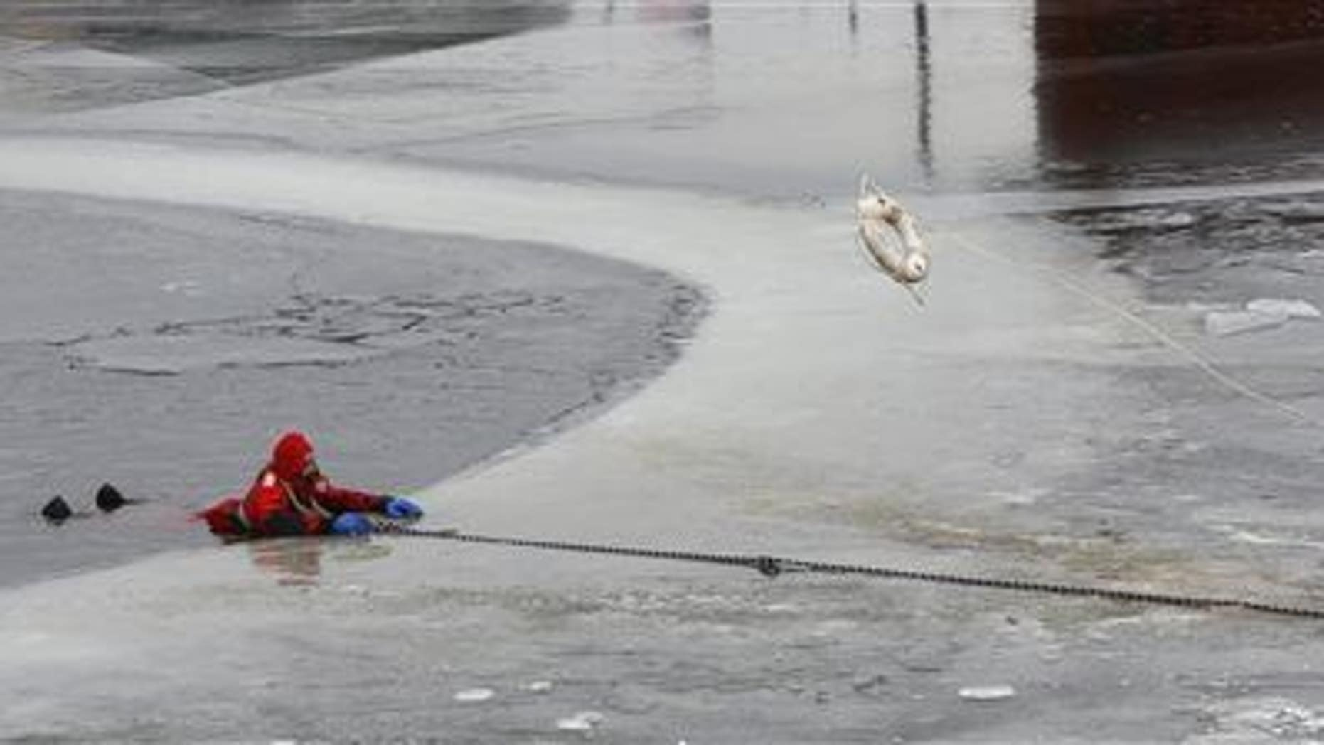 Members of the Dubuque Fire Department perform an ice-rescue training on Thursday, Dec. 4, 2014, in Dubuque, Iowa.