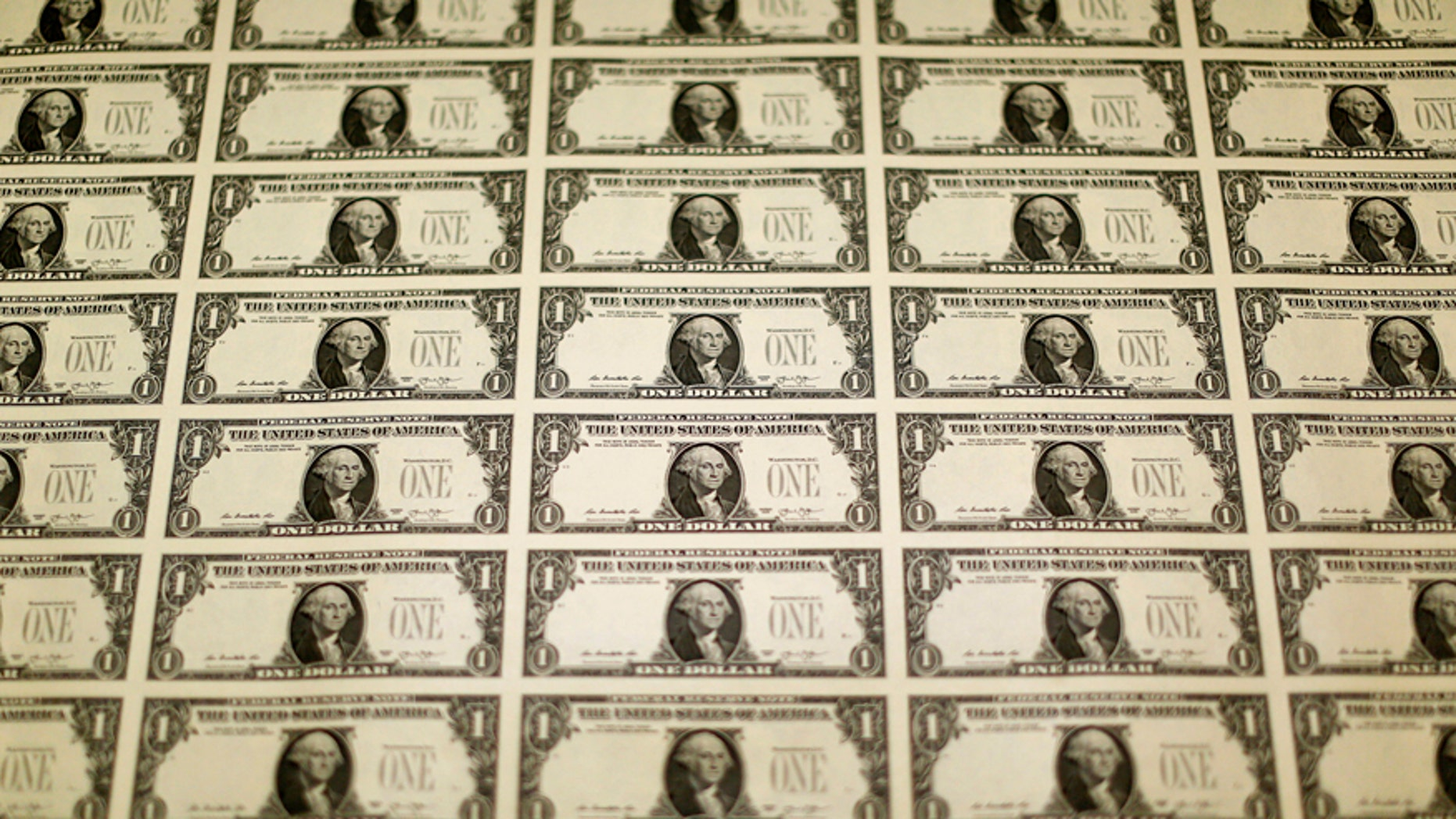 A sheet of the front side of United States one dollar bills is seen during production at the Bureau of Engraving and Printing in Washington November 14, 2014.