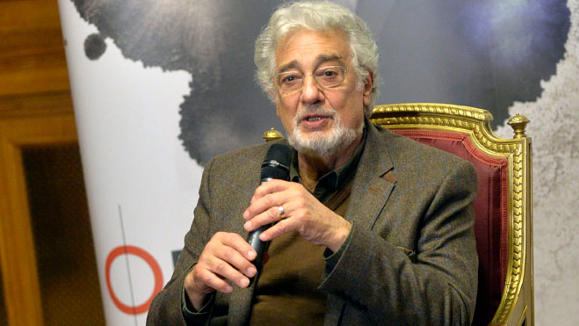 Spanish tenor Placido Domingo speaks during a press conference one day ahead of his performance at the Shakespeare gala as part of the Budapest Opera Ball in the Hungarian State Opera House in Budapest, Hungary, Friday, Feb. 5, 2016. (Zoltan Mathe/MTI via AP)