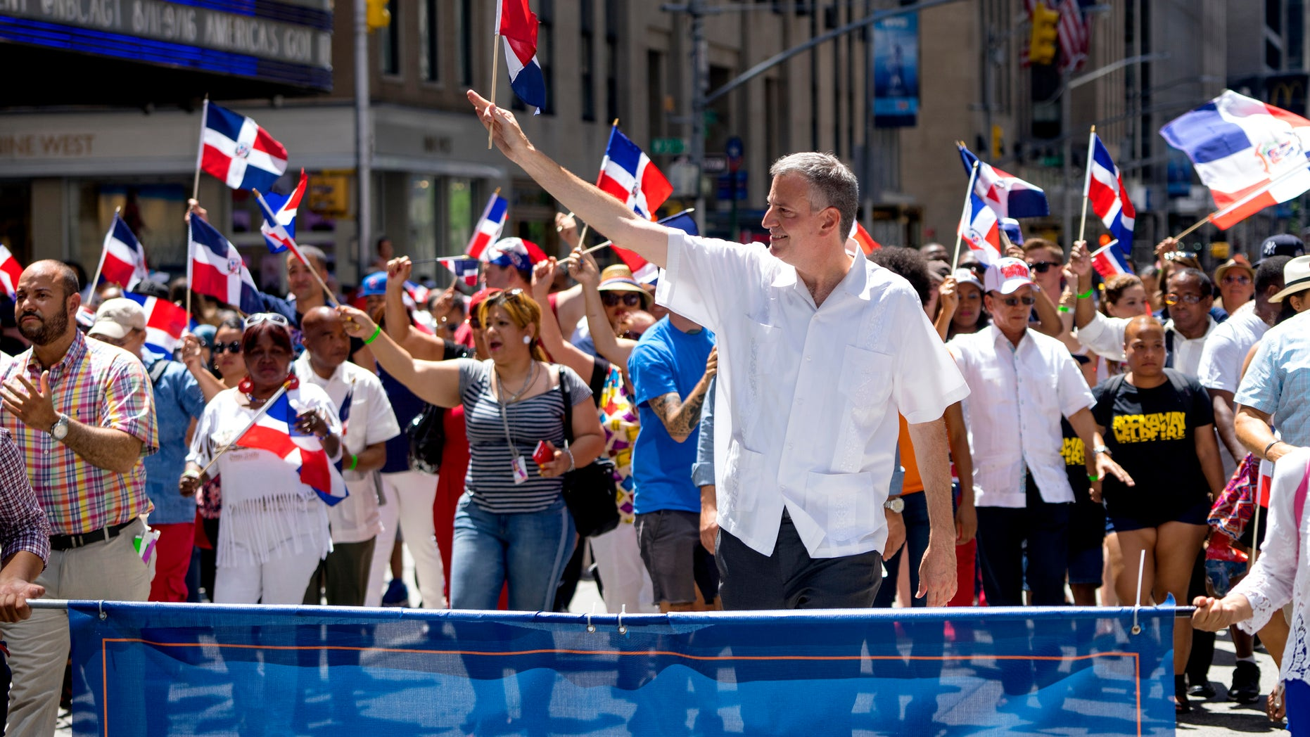 New York City Mayor Bill de Blasio walks in the Dominican Day Parade Sunday, Aug. 9, 2015, in New York.