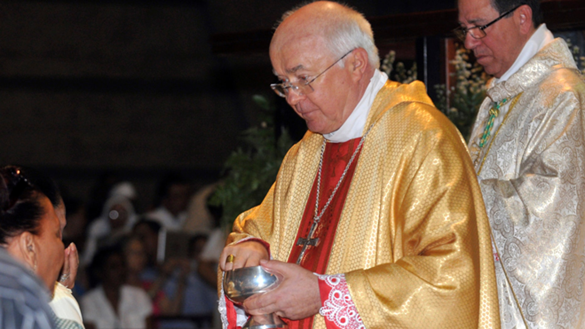 In this March 15, 2013, Archbishop Josef Wesolowski leads a Mass in Santo Domingo, Dominican Republic.