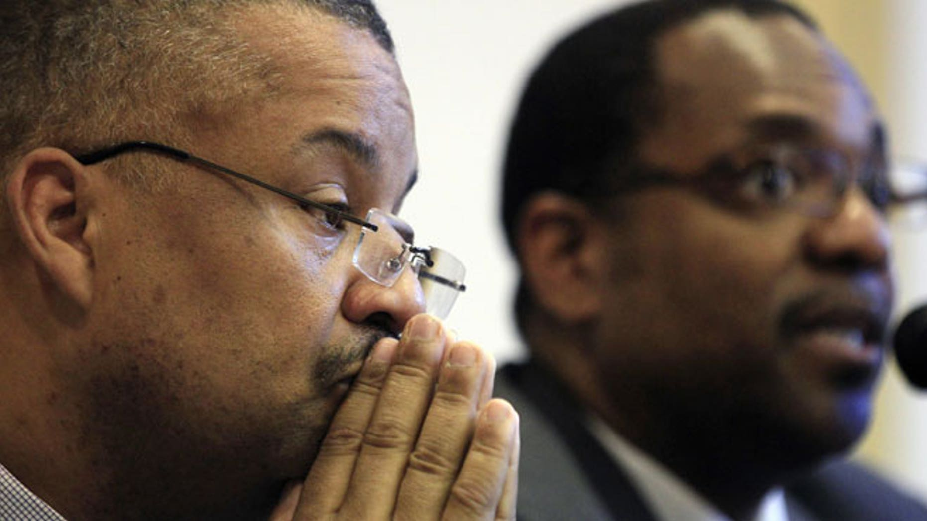 May 23, 2012: Newark Councilman Donald Payne Jr., left, son of the late New Jersey Rep. Donald Payne, listens as fellow Newark Councilman Ron Rice addresses a gathering in West Orange, N.J.