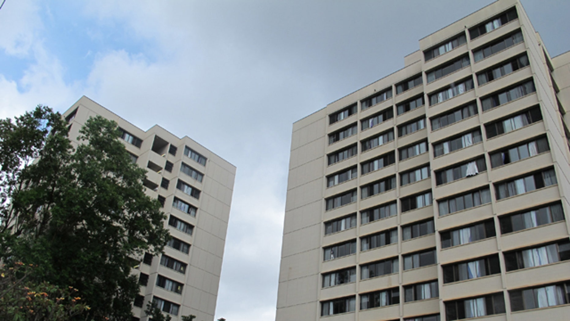 Aug. 17, 2015: The Hale Wainani dormitory is seen at the University of Hawaii in Honolulu. Two men fell from the 14th floor of the University of Hawaii dormitory, one of them to his death while trying to pull the other from a ledge, Honolulu police said. (AP Photo/Jennifer Sinco Kelleher)