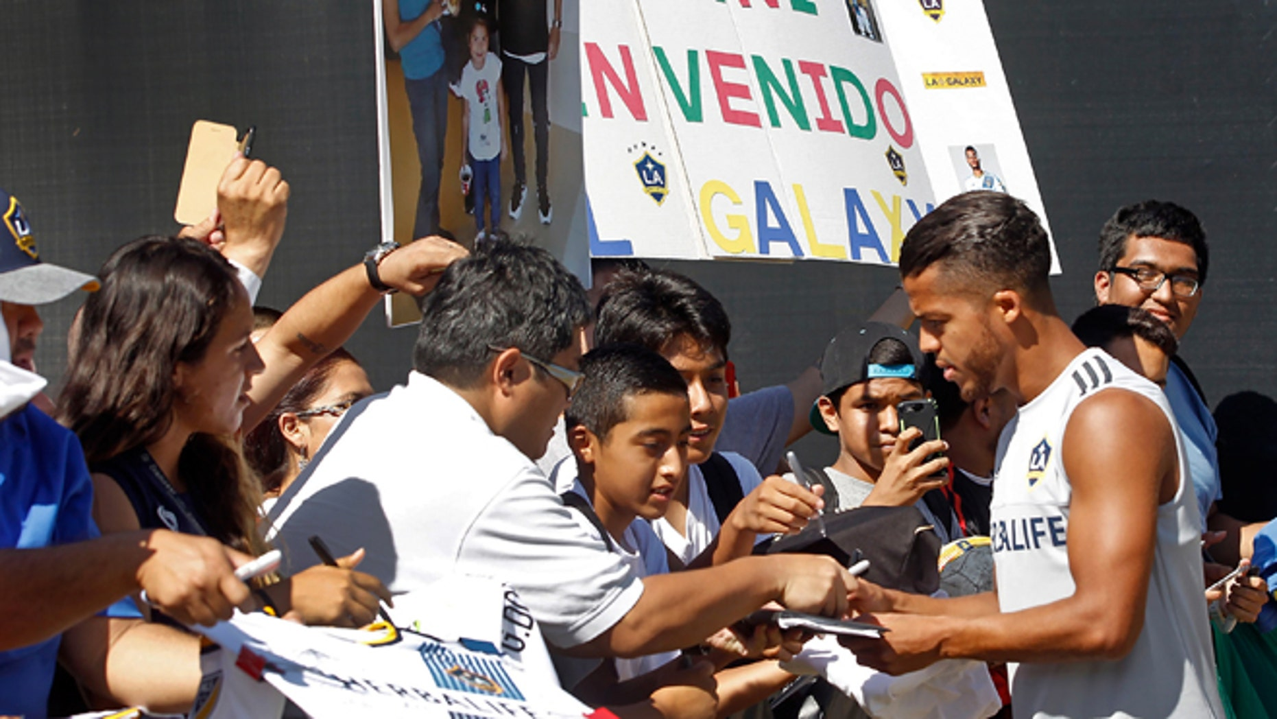 Los Angeles Galaxy forward Giovani dos Santos signs autographs before his first training with the MLS soccer team in Carson, Calif., on Tuesday, Aug. 4, 2015. After four years of courting dos Santos, the Galaxy signed the highest-profile Mexican star in their history to a designated player contract, paying a reported $7 million transfer fee. He will make his Major League Soccer debut on Sunday against the Seattle Sounders FC. (AP Photo/Nick Ut)