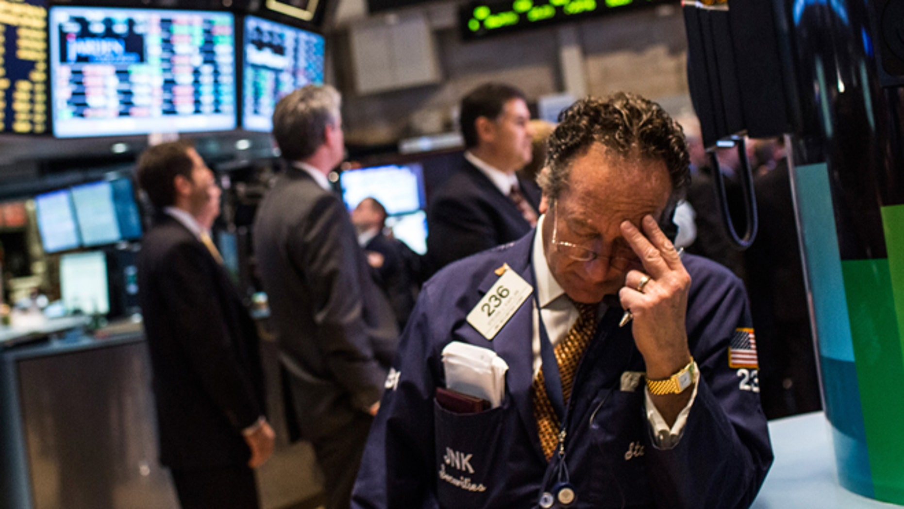 NEW YORK, NY - DECEMBER 04:  A trader works on the floor of the New York Stock Exchange on December 4, 2013 in New York City. The Dow Jones Industrial Average dipped over 100 points during trading before bouncing back to approximately 15,900; the market peaked at a record high last month at over 16,000 points.  (Photo by Andrew Burton/Getty Images)
