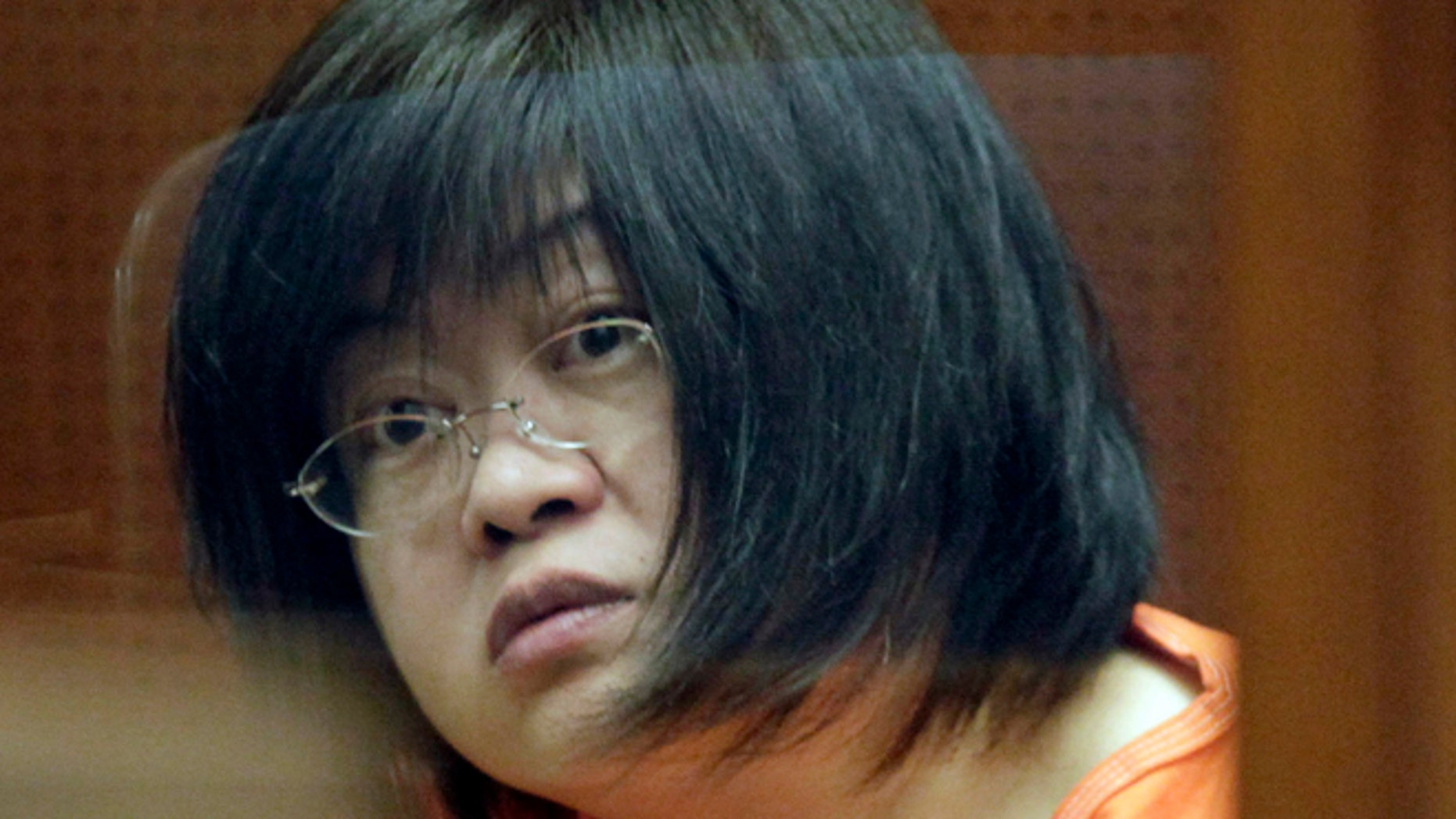 """March 16, 2012: Dr Hsiu Ying """"Lisa"""" Tseng listens in court during her arraignment, in Los Angeles."""