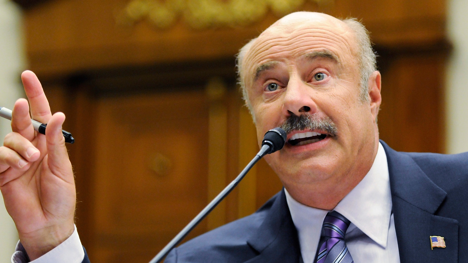 Dr. Phil McGraw, television personality and psychologist, talks about cyber-bullying during a hearing of the Healthy Families and Communities Subcommittee of the U.S. House Committee on Education and Labor, on Capitol Hill in Washington, June 24, 2010.