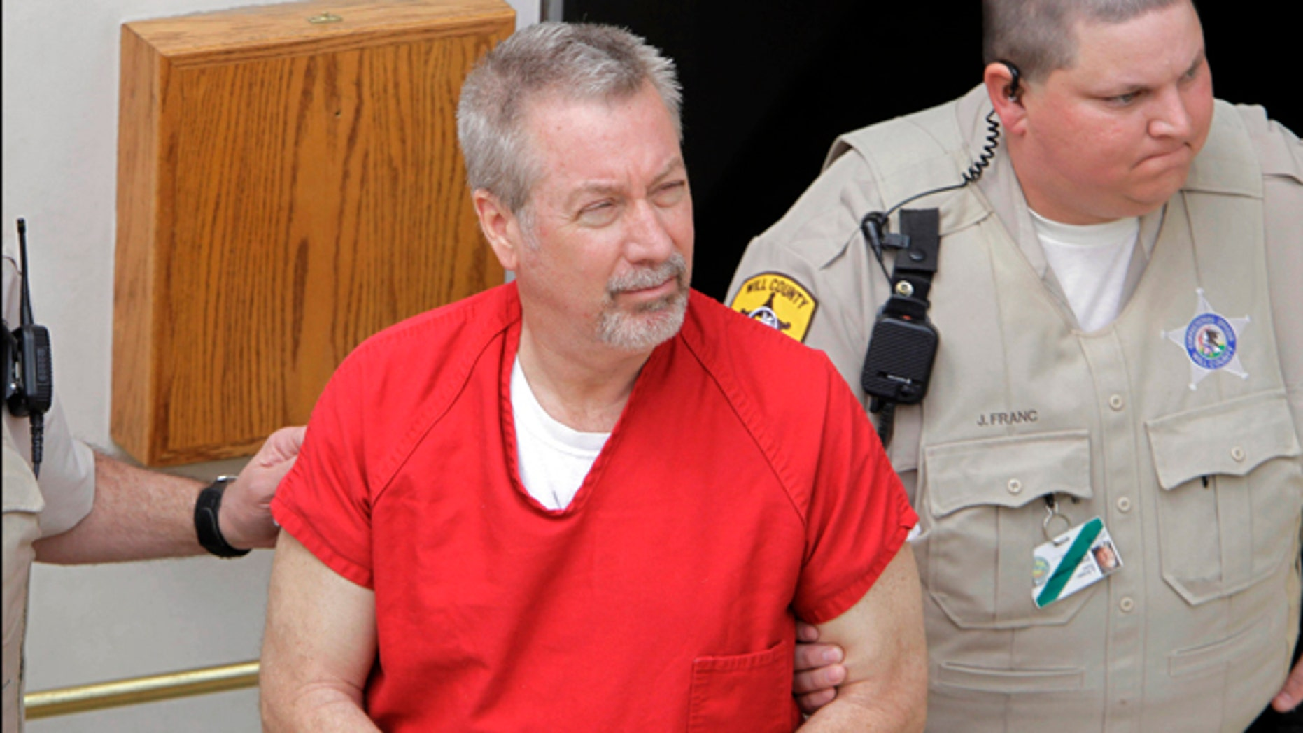 May 8, 2009: File photo, former Bolingbrook, Ill., police sergeant Drew Peterson leaves the Will County Courthouse in Joliet, Ill., after his arraignment on charges of first-degree murder in the 2004 death of his former wife Kathleen Savio.