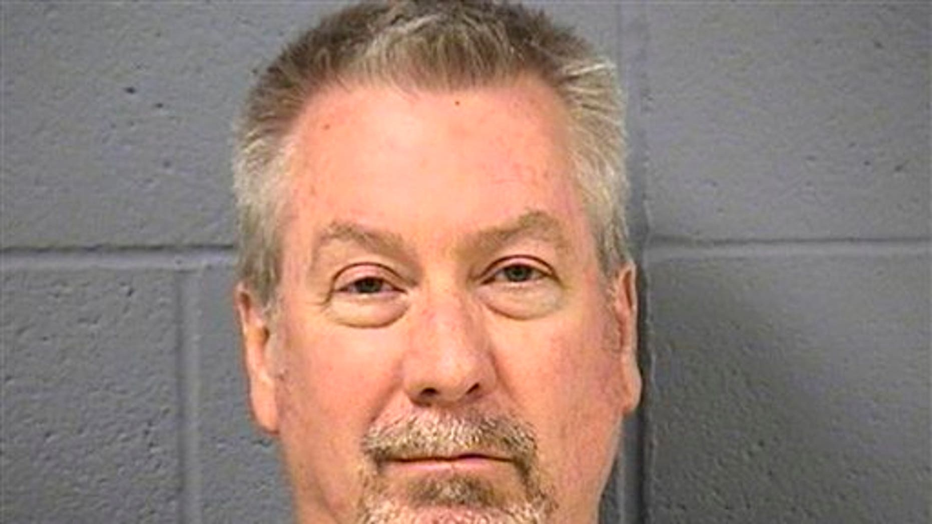 July 23, 2012: In this May 7, 2009 file booking photo provided by the Will County Sheriff's office in Joliet, Ill., former Bolingbrook, Ill., police sergeant Drew Peterson is shown.