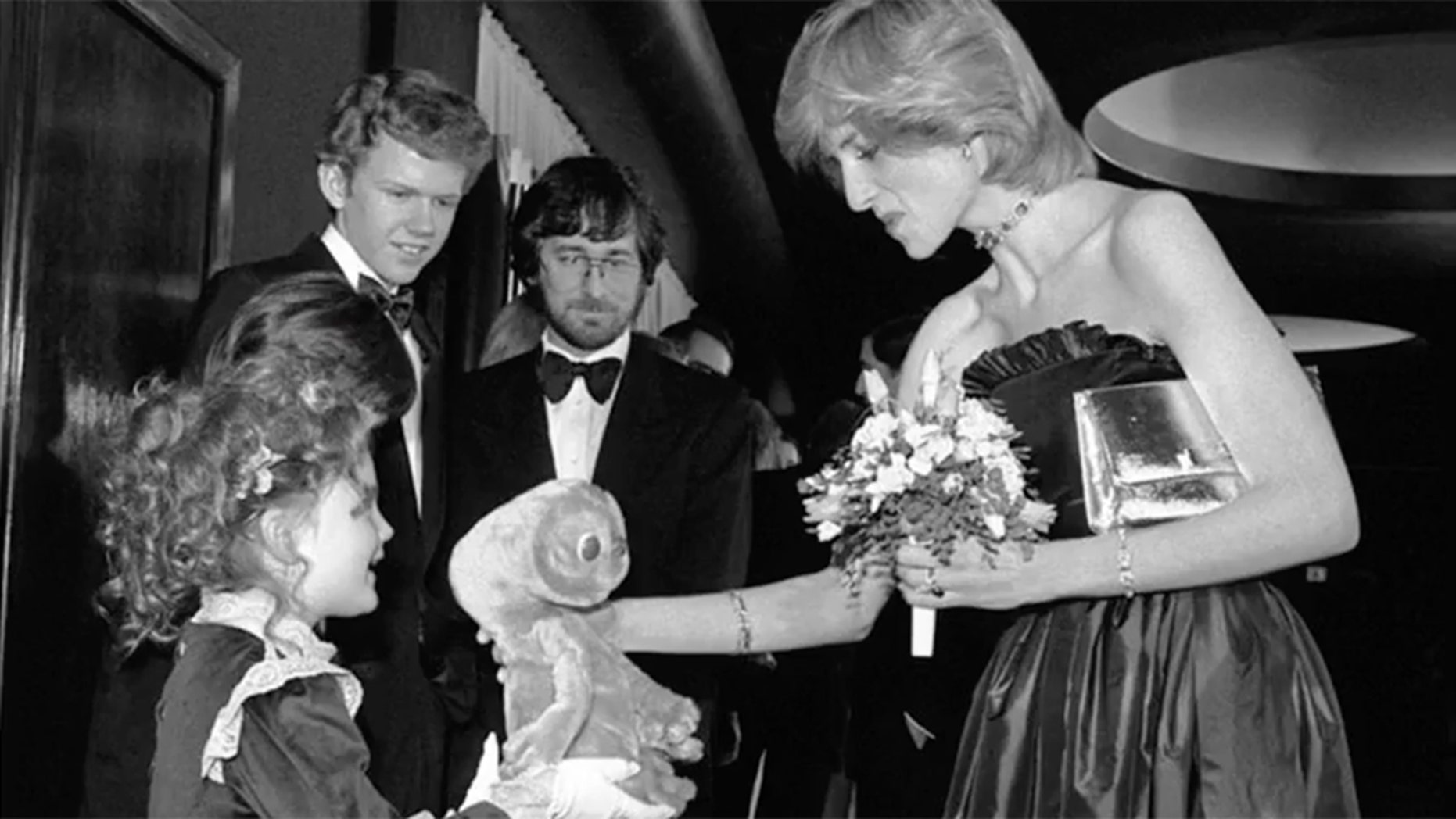 Drew Barrymore, 7, gives Princess Diana a stuffed animal.