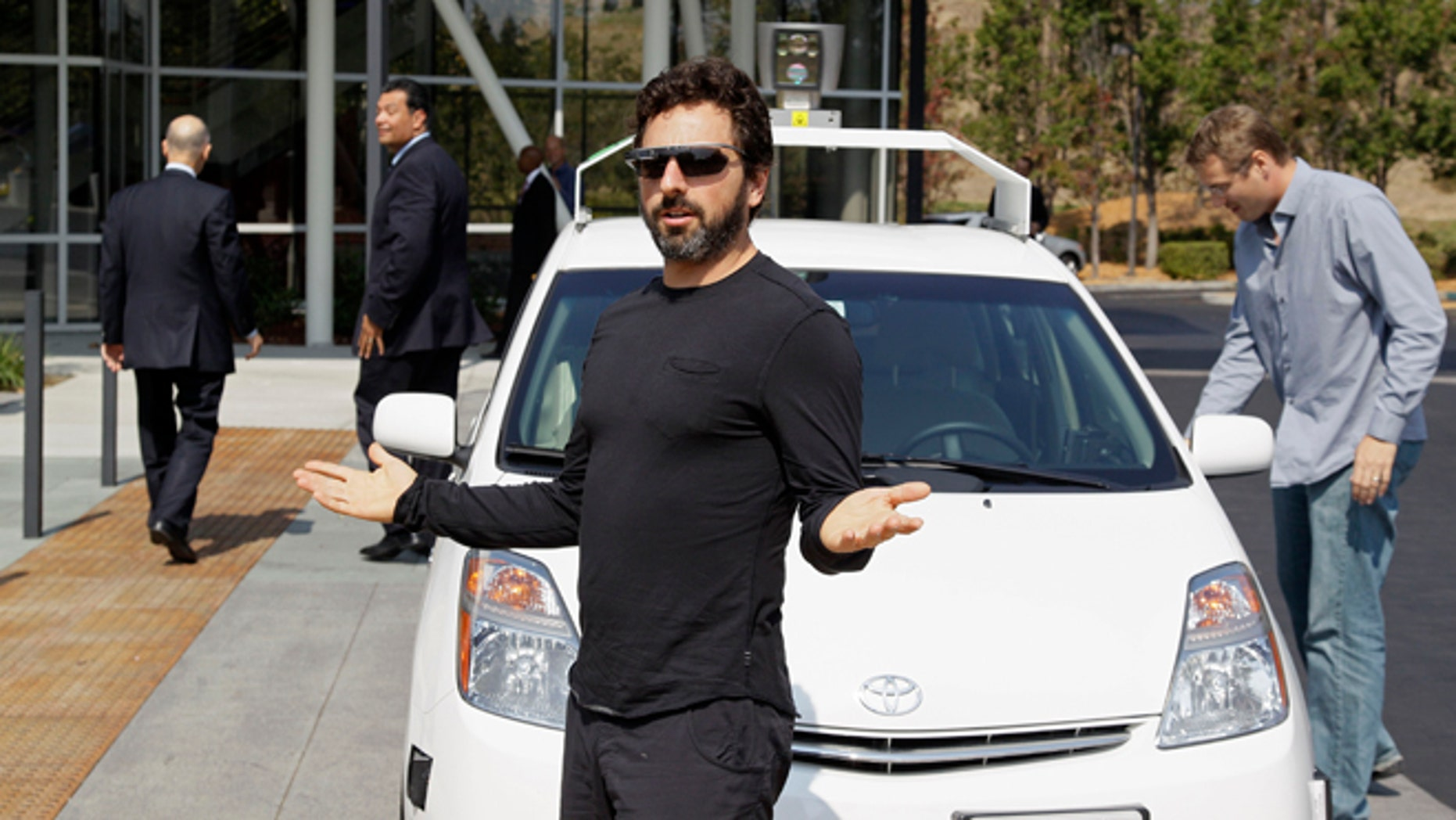 Sept. 25, 2012: Google co-founder Sergey Brin gestures after riding in a driverless car with California Gov. Jerry Brown, left, and state Sen. Alex Padilla, second from left.