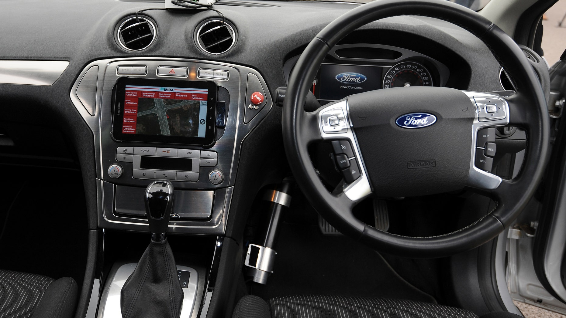 The interior of a driverless car during testing at the headquarters of motor industry research organization MIRA at Nuneaton in the West Midlands, England.