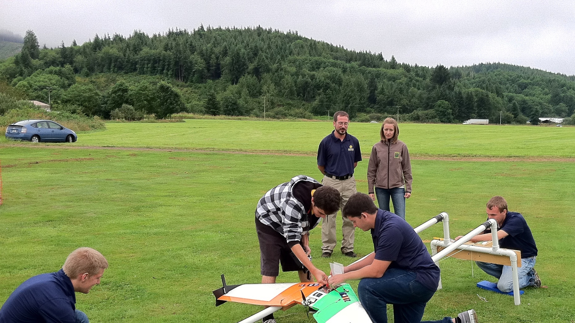 July 26, 2012: This photo provided by Embry-Riddle Aeronautical University shows students demonstrating the launch catapult for their drone aircraft near Tillamook, Ore.