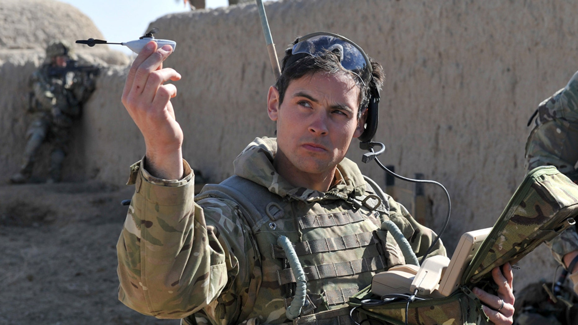 Sergeant Scott Weaver, of The Queens Royal Lancers launches a Black Hornet, Nano UAV from a compound in Afghanistan.