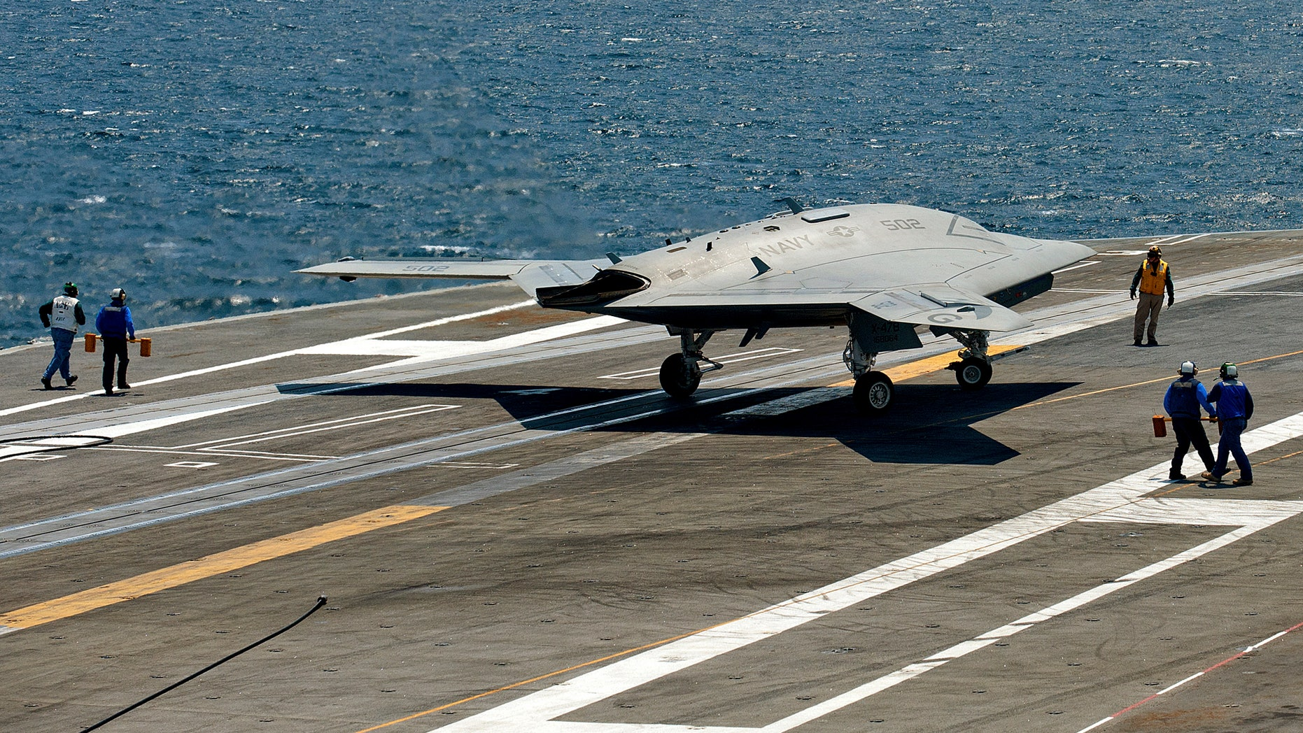 July 10, 2013: An X-47B pilot-less drone combat aircraft comes to a stop after landing on the deck of the USS George H.W. Bush aircraft carrier in the Atlantic Ocean off the coast of Norfolk, Virginia .