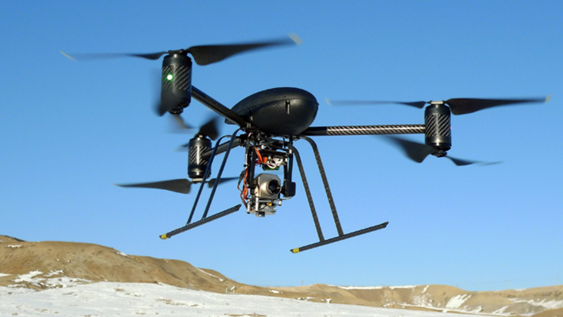 In this Jan. 8, 2009, photo provided by the Mesa County, Colo., Sheriff's Department, a small Draganflyer X6 drone is photographed during a test flight in Mesa County, Colo., with a Forward Looking Infer Red payload.