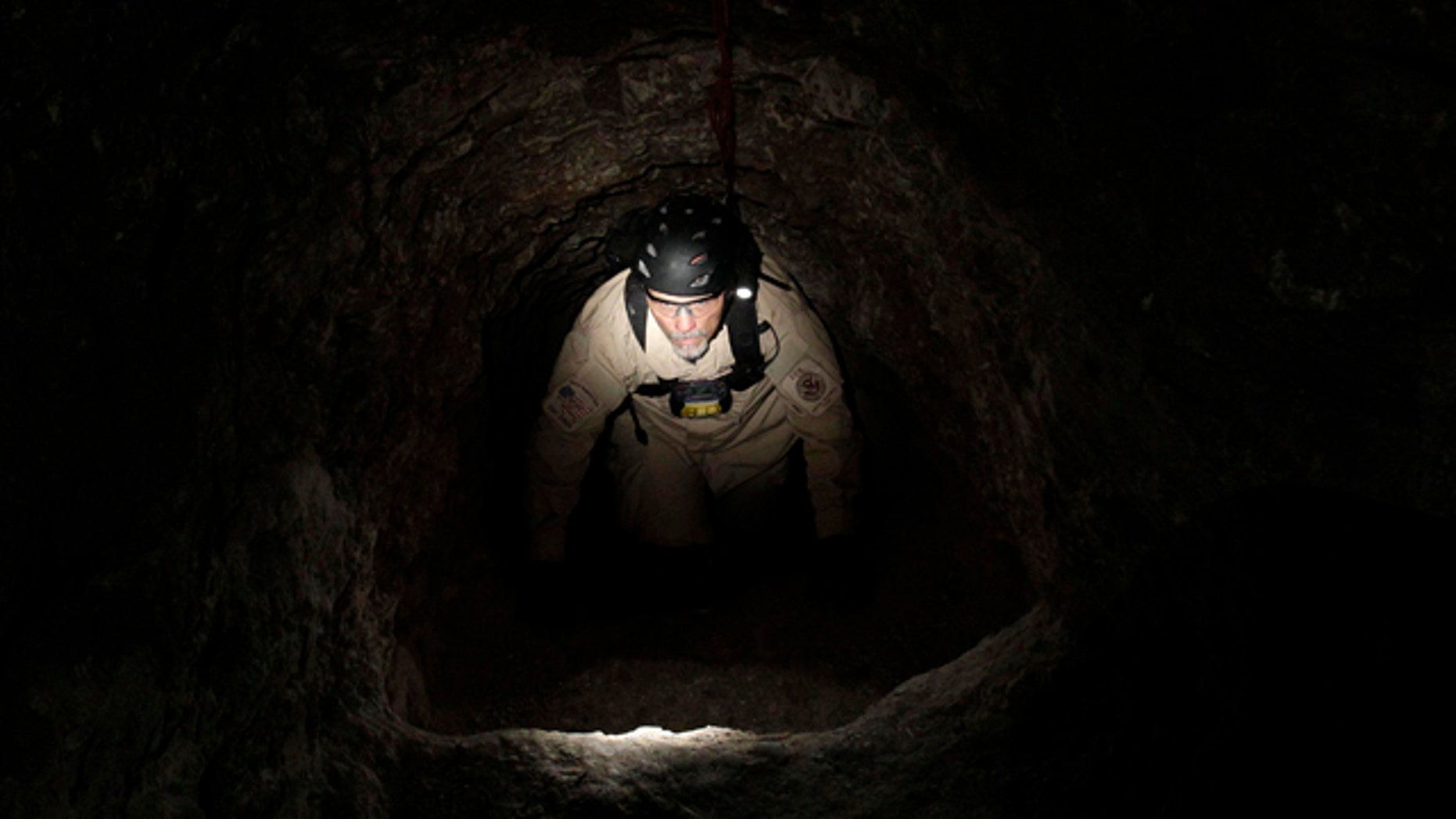 A U.S. Immigration and Customs Enforcement agent climbs in a  drug tunnel in San Diego on  Dec. 2, 2010. Tunnels are a commonly used method to transport drugs from Mexico to the U.S.
