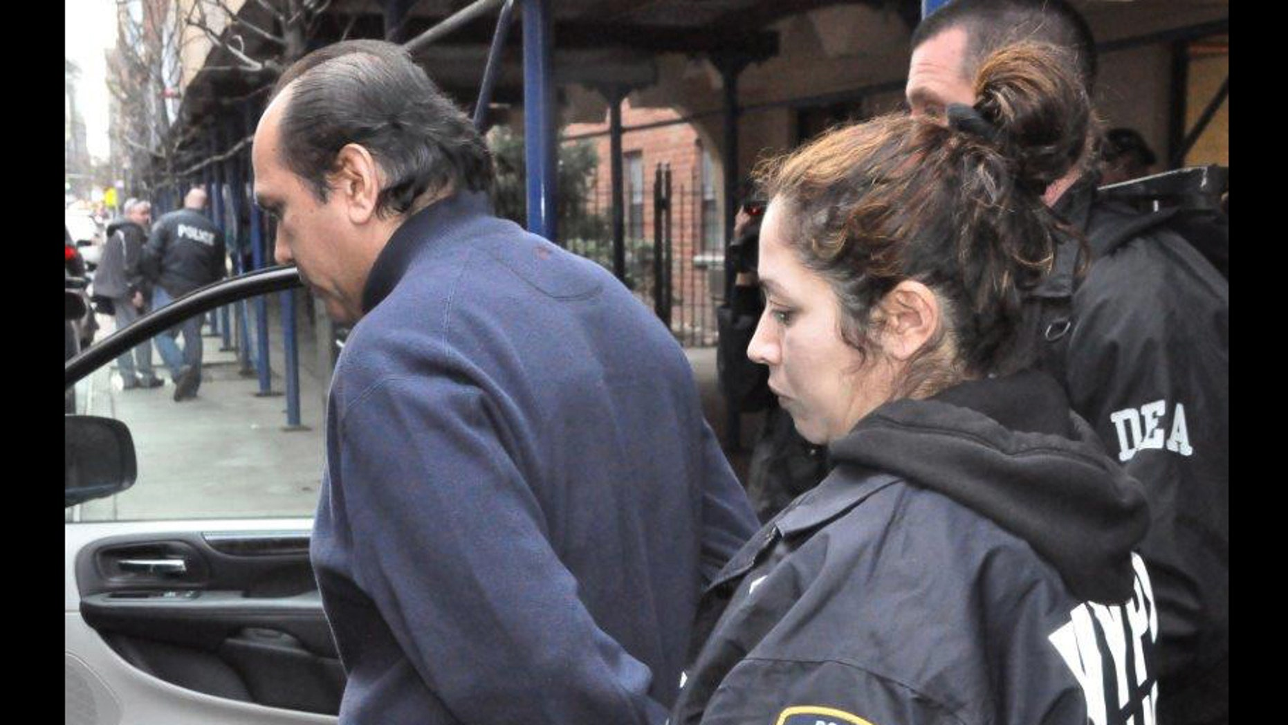 Dr. Hector Castro being arrested.