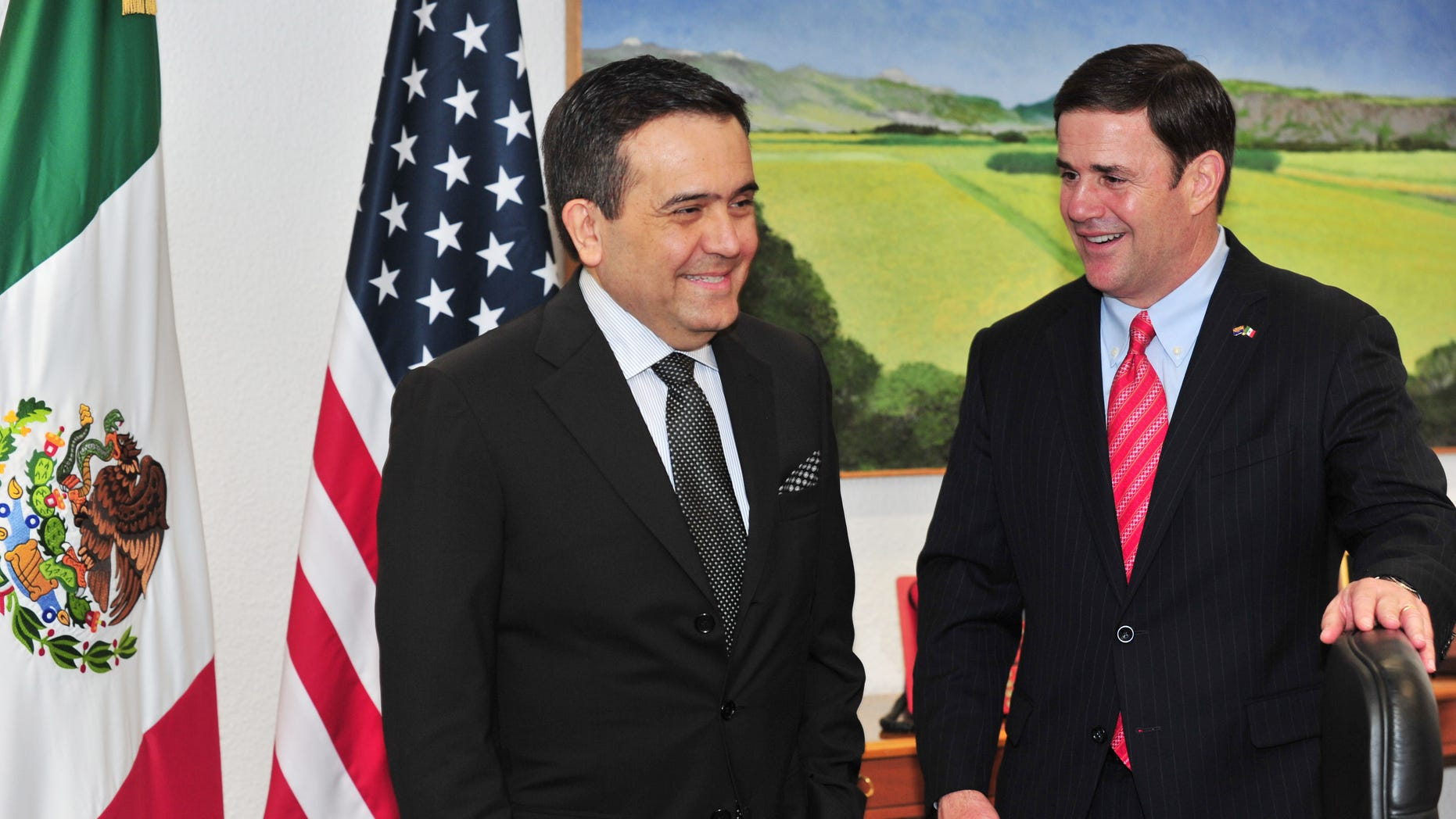 In this June 19, 2015 photo provided by the Office of Governor Doug Ducey, the Arizona governor, right, meets with Mexicoâs Secretary of the Economy, Ildefonso Guajardo Villarreal, also a graduate of Arizona State University, during Ducey's visit to Mexico City. It was Ducey's first trip to Mexico since his inauguration in January. (Victor Abreu/Office of Governor Doug Ducey, via AP)