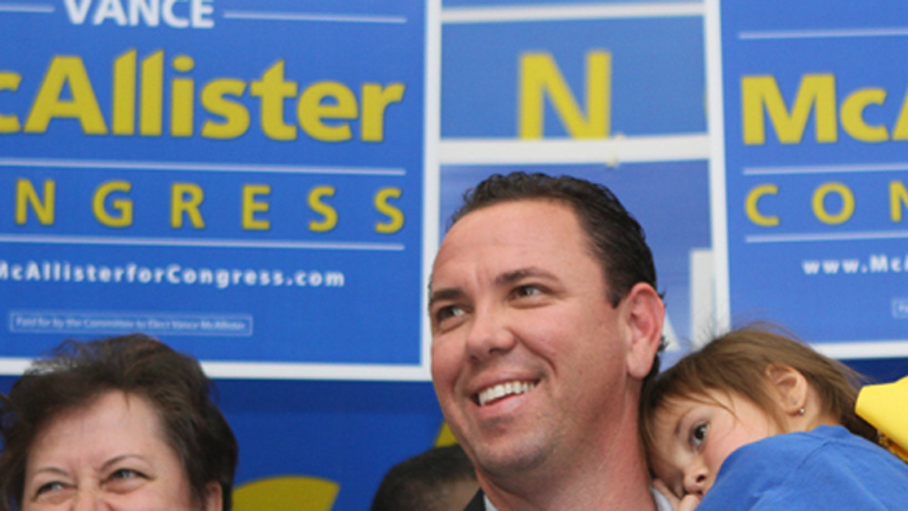 FILE: Sat., Nov. 16, 2013: Republican Vance McAllister celebrates with his family and supporters after winning a congressional district election in Louisiana.