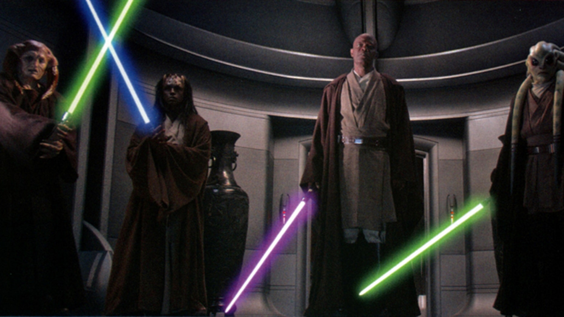 Saesee Tiin, Agen Kolar, Mace Windu, and Kit Fisto ignite their lightsabers to arrest Supreme Chancellor Palpatine in Star Wars Episode III: Revenge of the Sith.