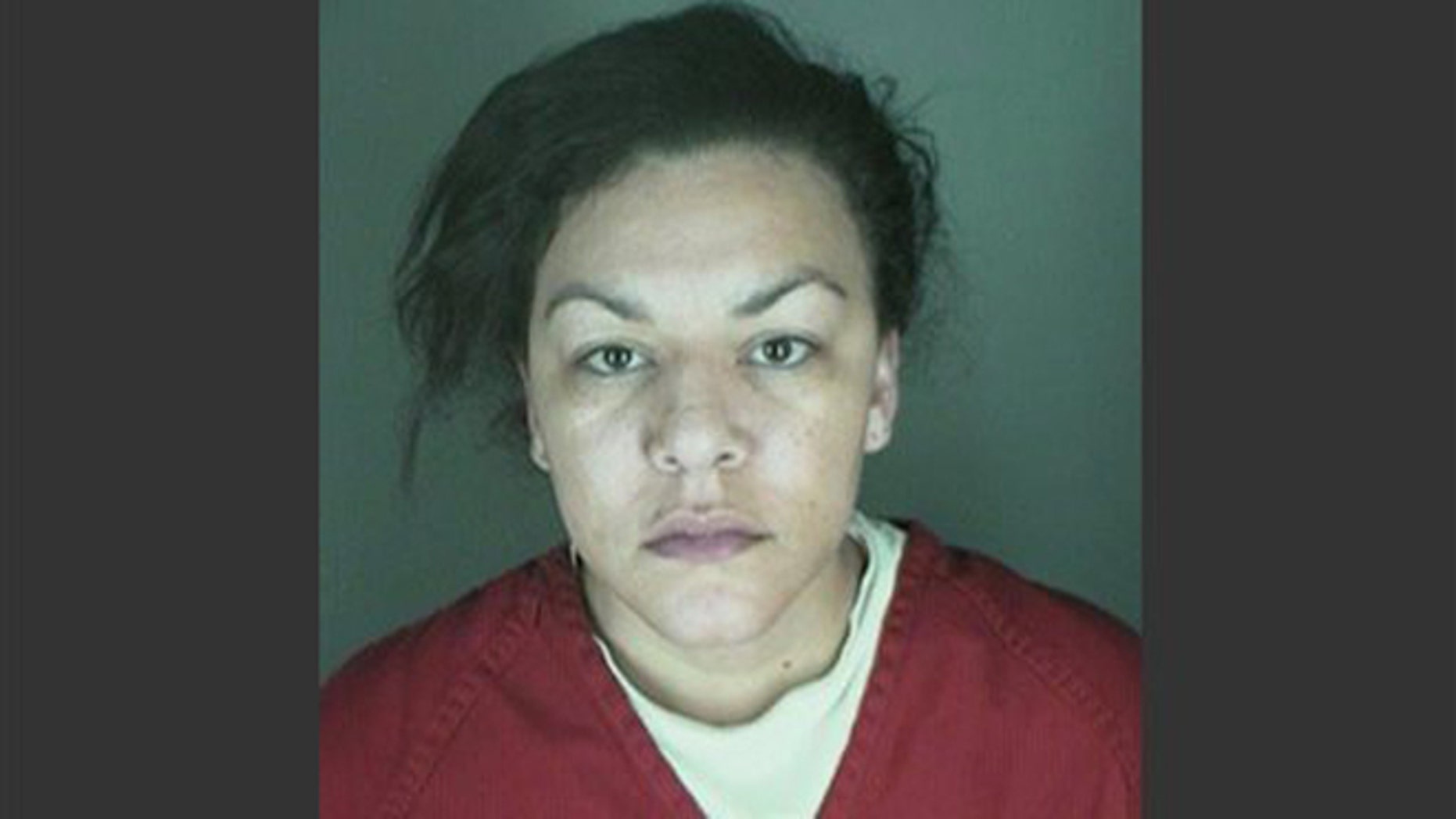 This undated booking photo provided by the Longmont Police Department shows Dynel Lane, 34, who is accused of stabbing a pregnant woman in the stomach and removing her baby, while the expectant mother visited her home to buy baby clothes advertised on Craigslist authorities said.