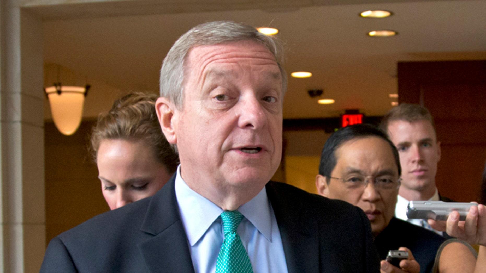 FILE: Sept. 4, 2013: Sen. Dick Durbin, D-Ill., walks at the Capitol in Washington, D.C.